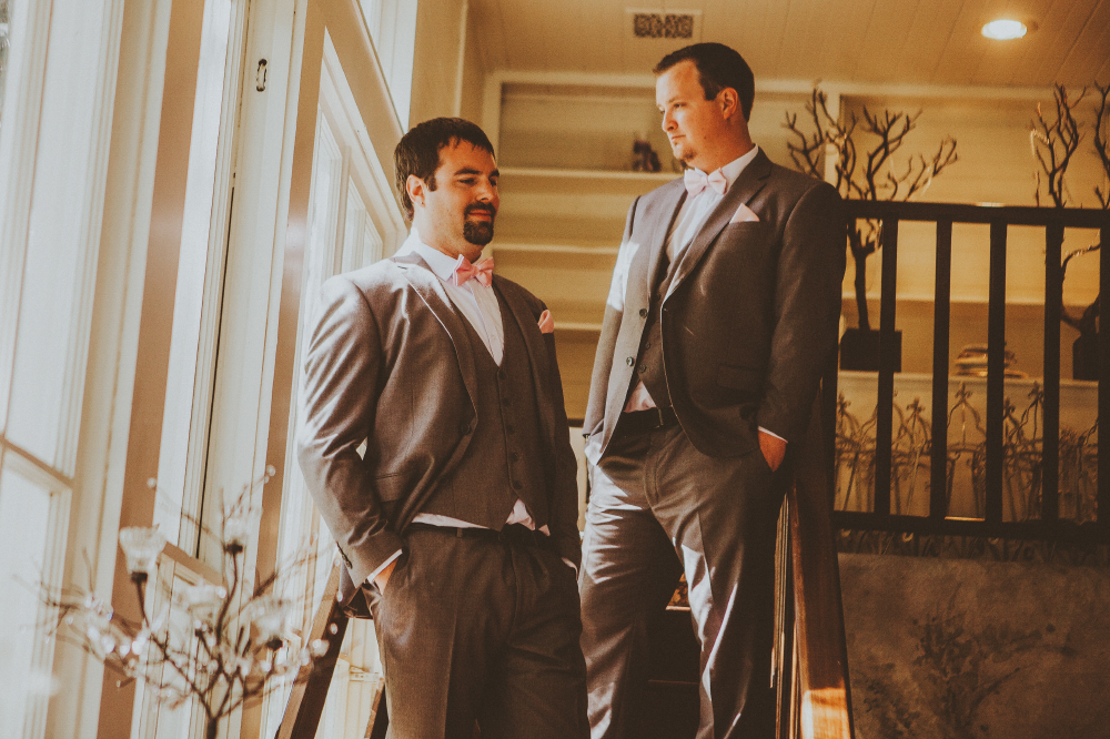 san diego wedding   photographer   men in grey suits posing on a staircase