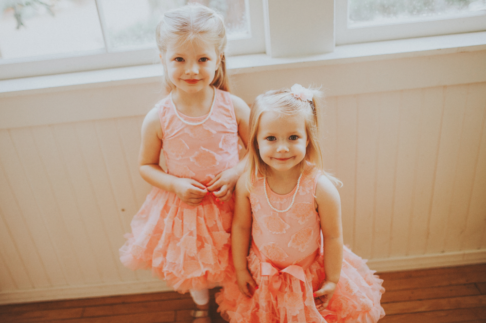 san diego wedding   photographer   children in pink dresses smiling at camera