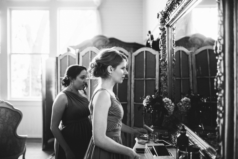 san diego wedding   photographer   monotone shots of woman in front of mirror looking into mirror
