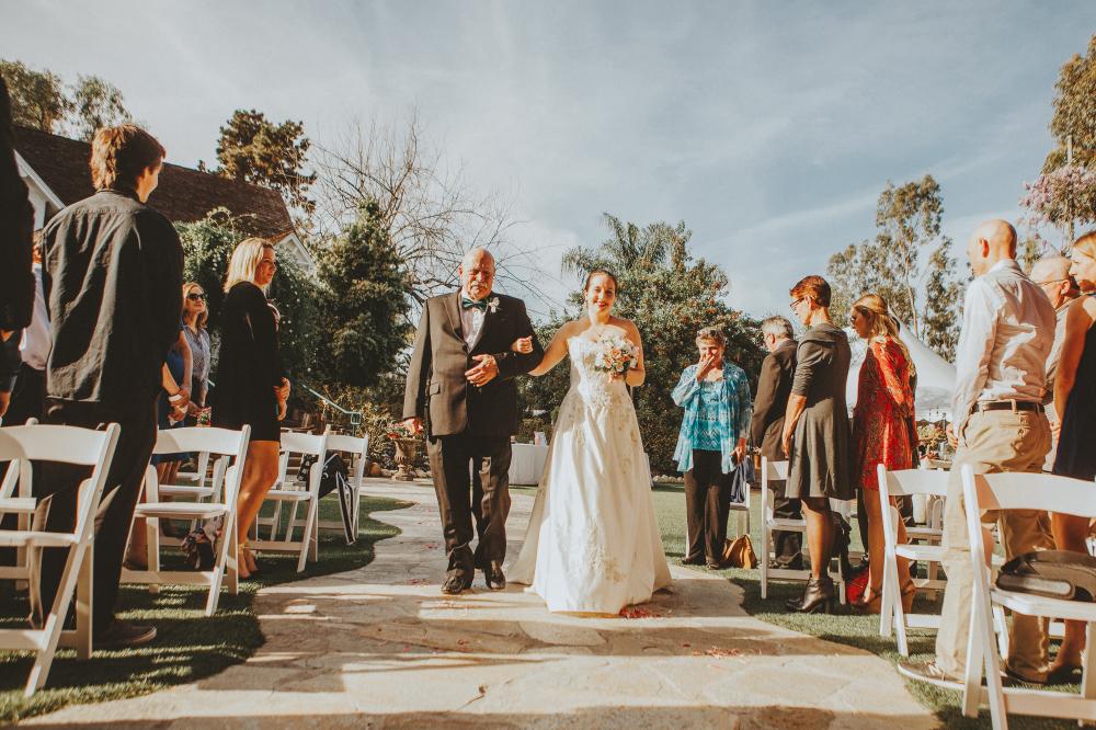 san diego wedding   photographer   bride with arm around dad's hand walking down the aisle