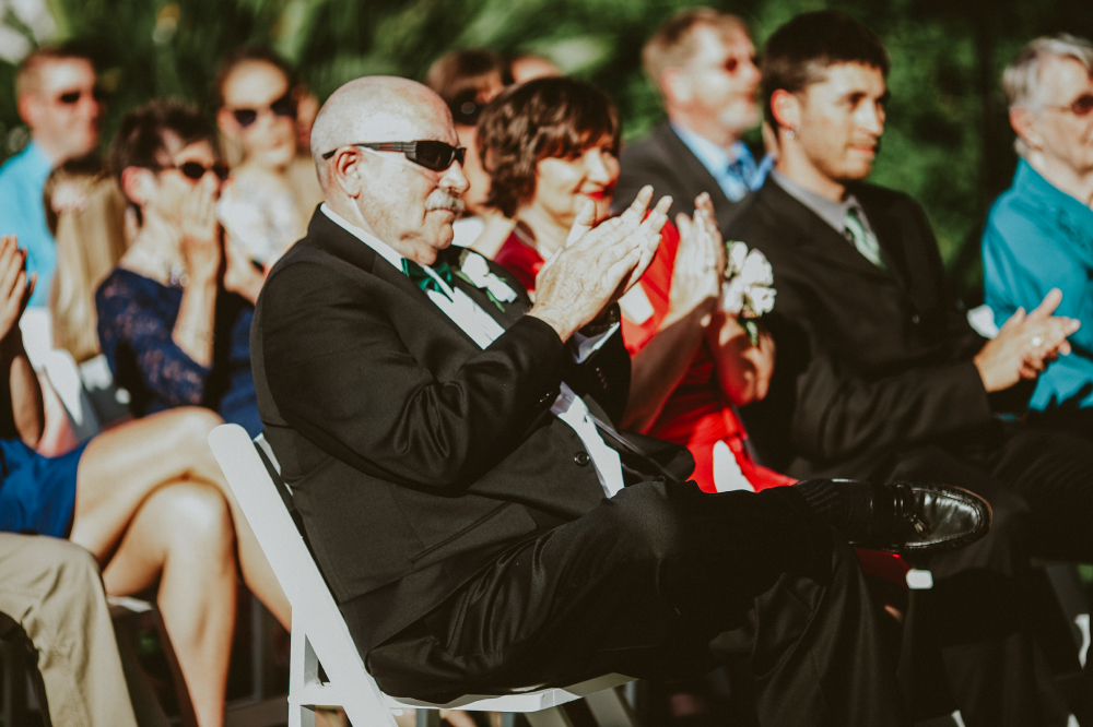san diego wedding   photographer   audience with old man in shades applauding