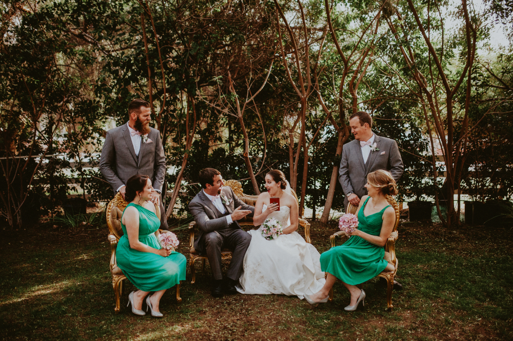 san diego wedding   photographer   shot of bride and groom surrounded by bridesmaids and   groomsmen