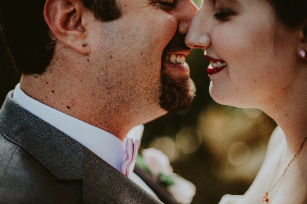 san diego wedding   photographer   zoomed in shot of bride and groom about to kiss