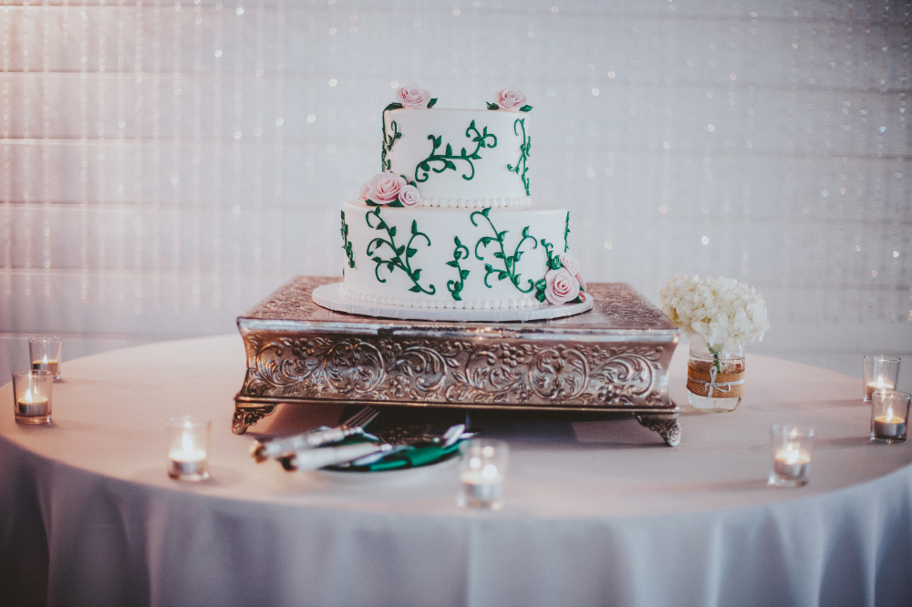 san diego wedding   photographer   white wedding cake with green leaves and pink flowers