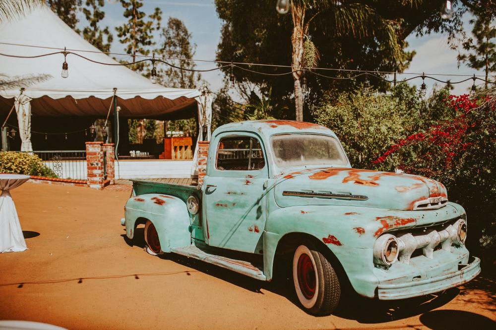 san diego wedding   photographer   old style light blue truck in sunlight