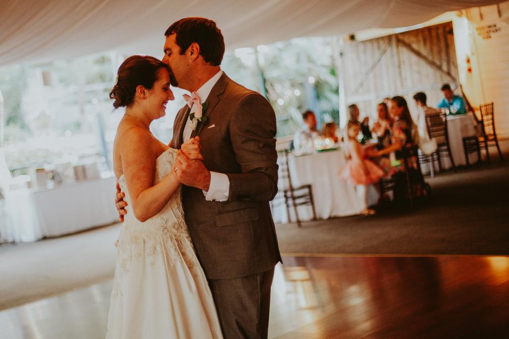 san diego wedding   photographer   groom kissing bride's forehead on dance floor