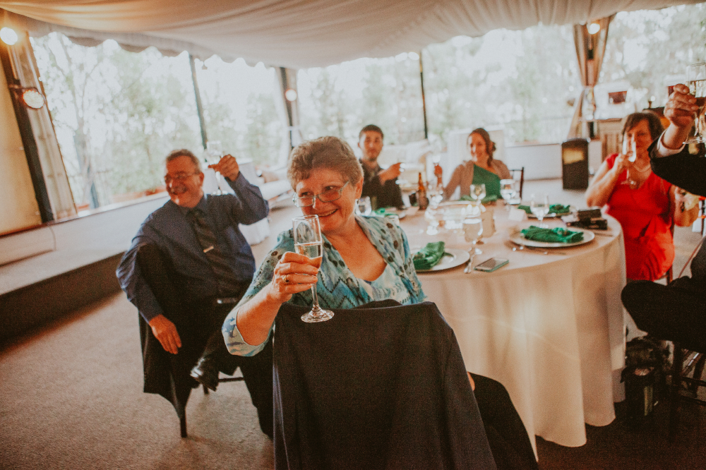 san diego wedding   photographer   group of people in a table lifting champagne glasses
