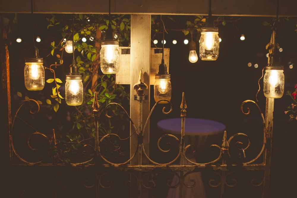 san diego wedding   photographer   low lgiht shot of lamps made out of jars