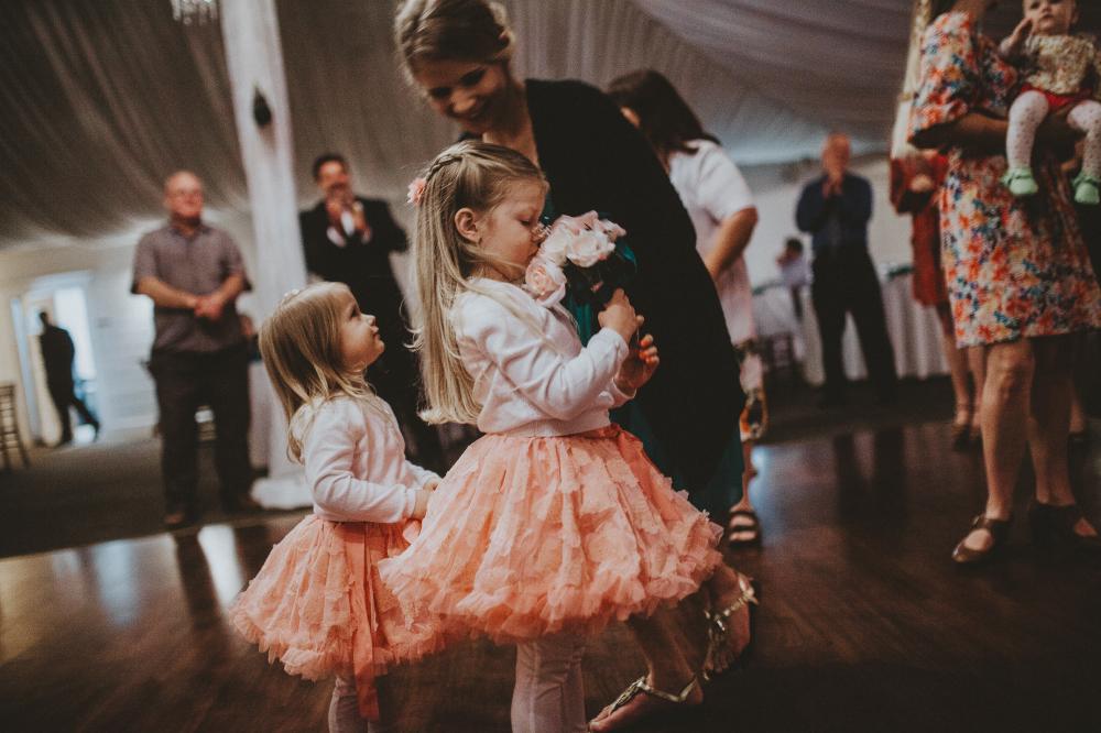 san diego wedding   photographer   children in pastel dresses smelling bouquet