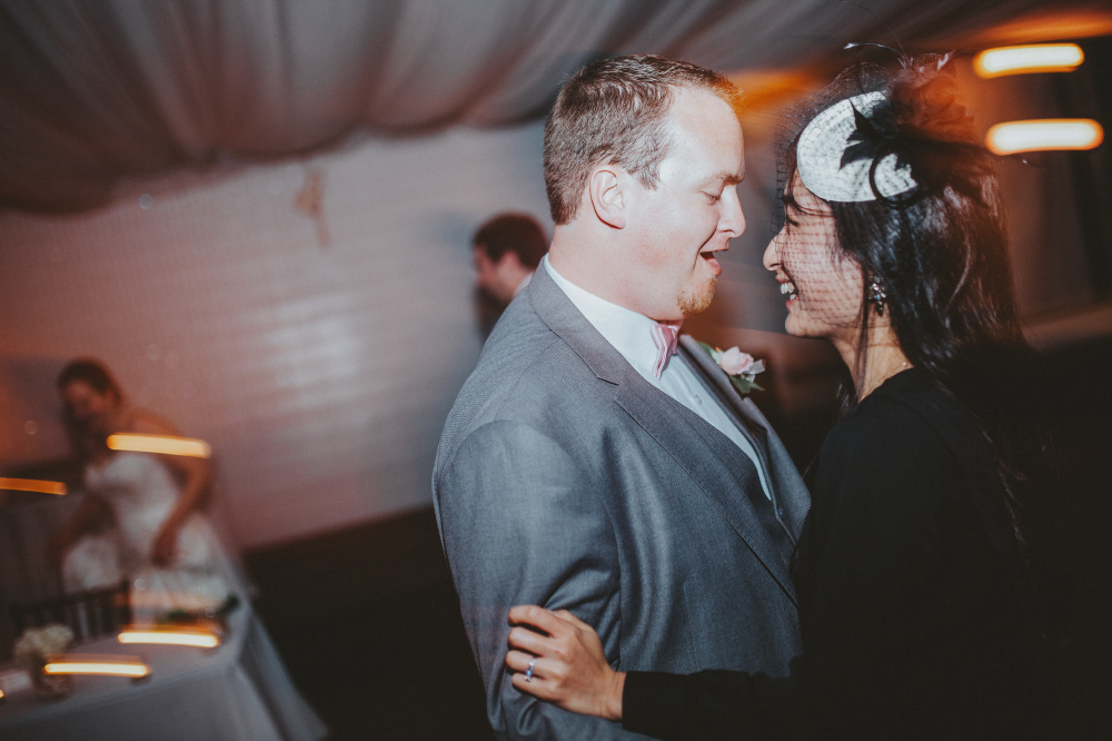 san diego wedding   photographer   man in grey suit dancing with woman in black dress