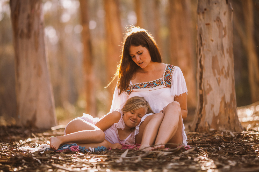san diego wedding   photographer   child laying her head on woman in white's lap