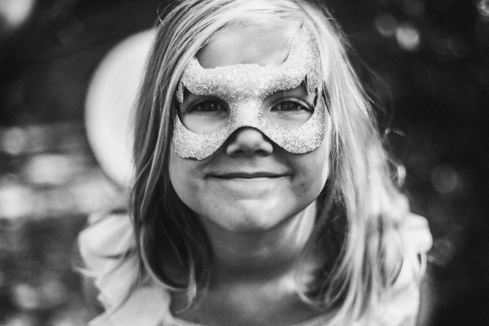 san diego wedding   photographer   monotone shot of child in mask looking at camera