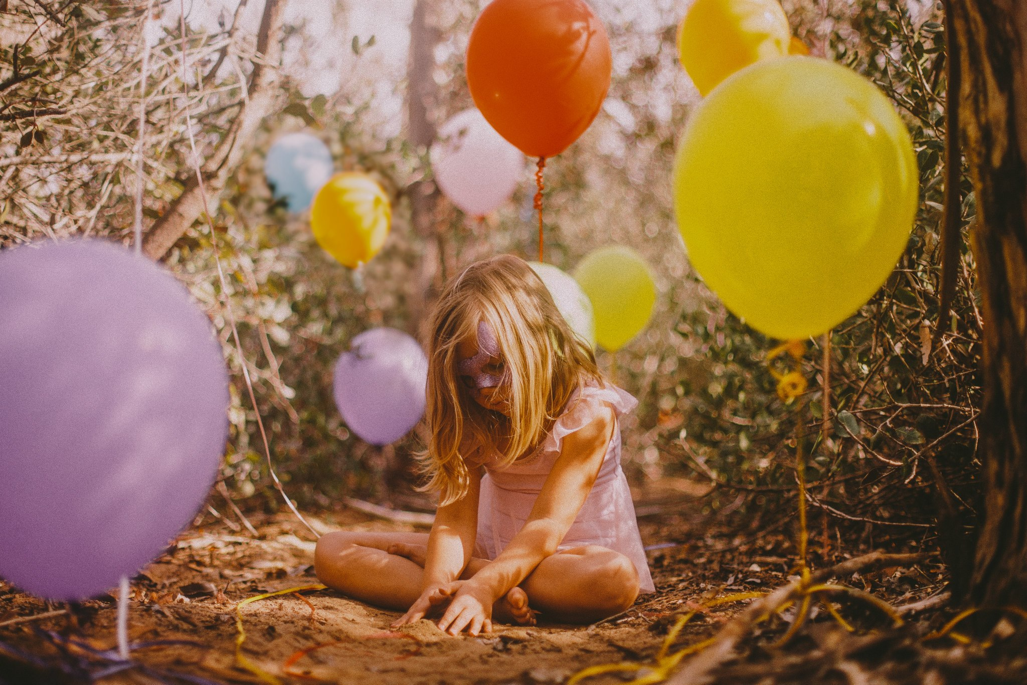 san diego wedding   photographer   child in mask sitting on the ground playing with dirt