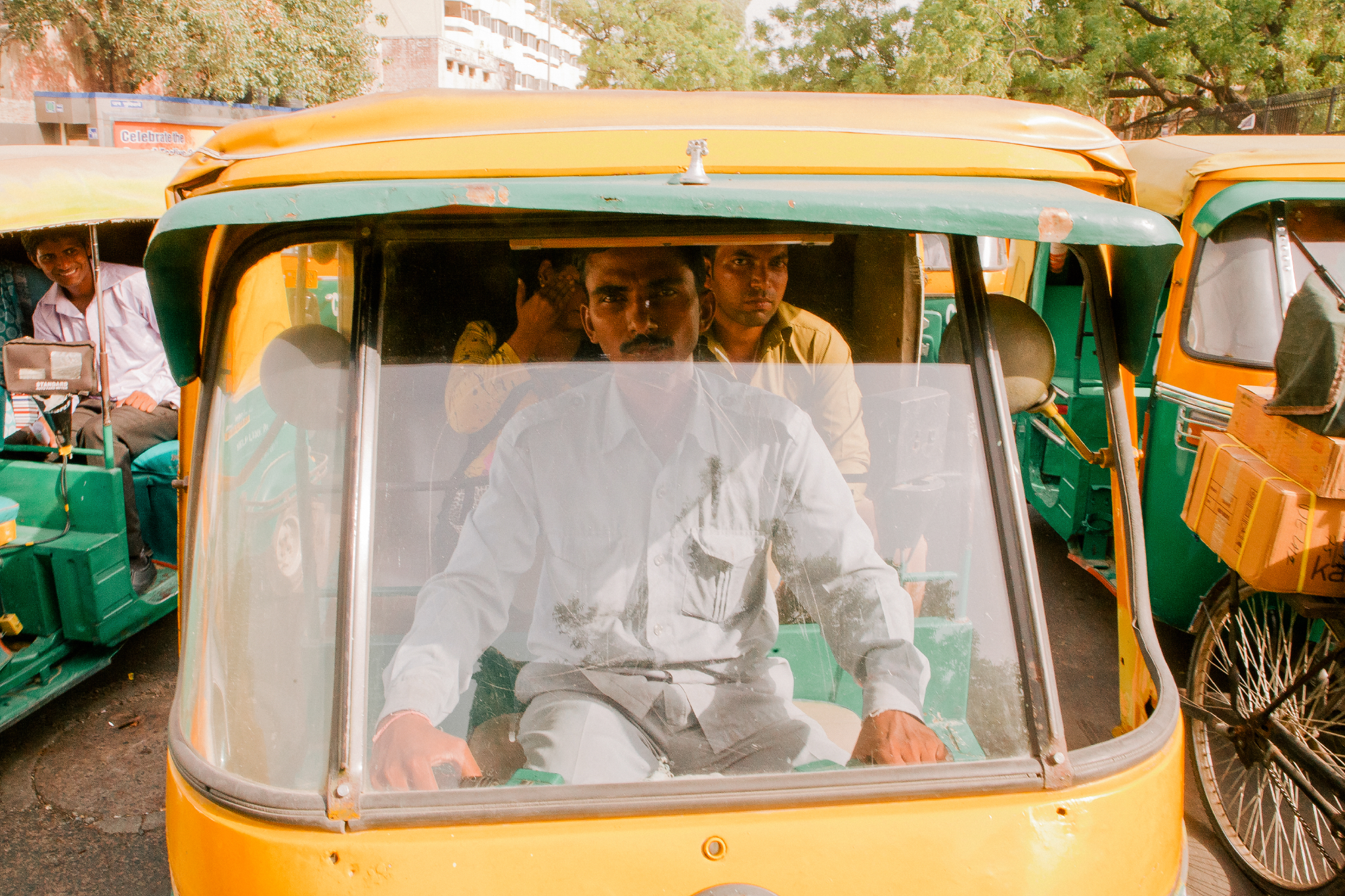san diego wedding   photographer | man driving a tuktuk looking through window