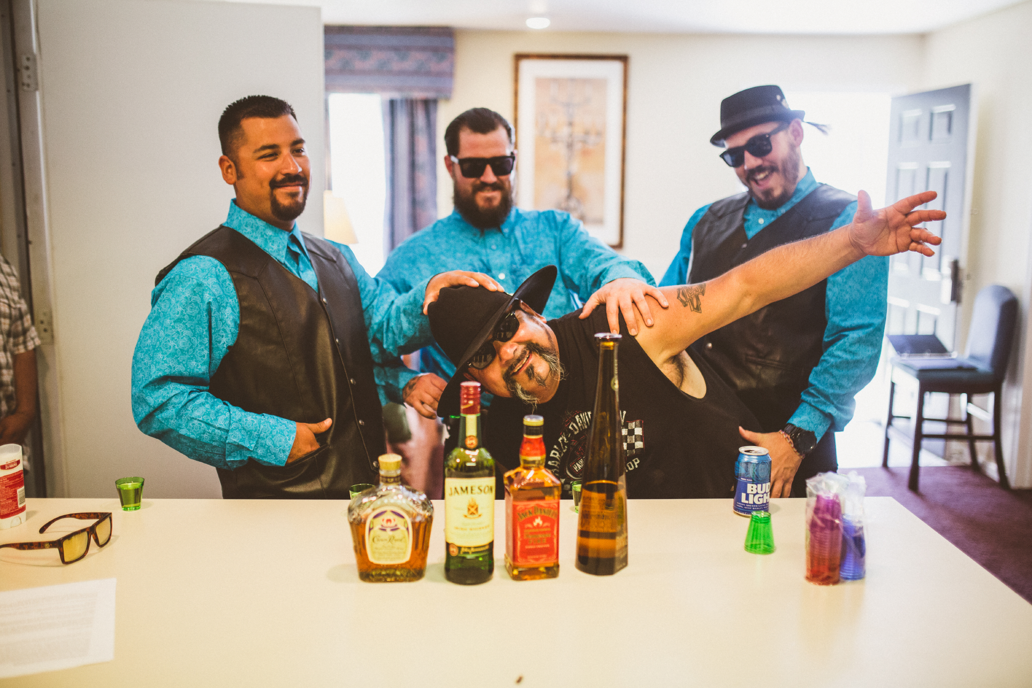 san diego wedding   photographer   men in vests and hats posing in front of liquor