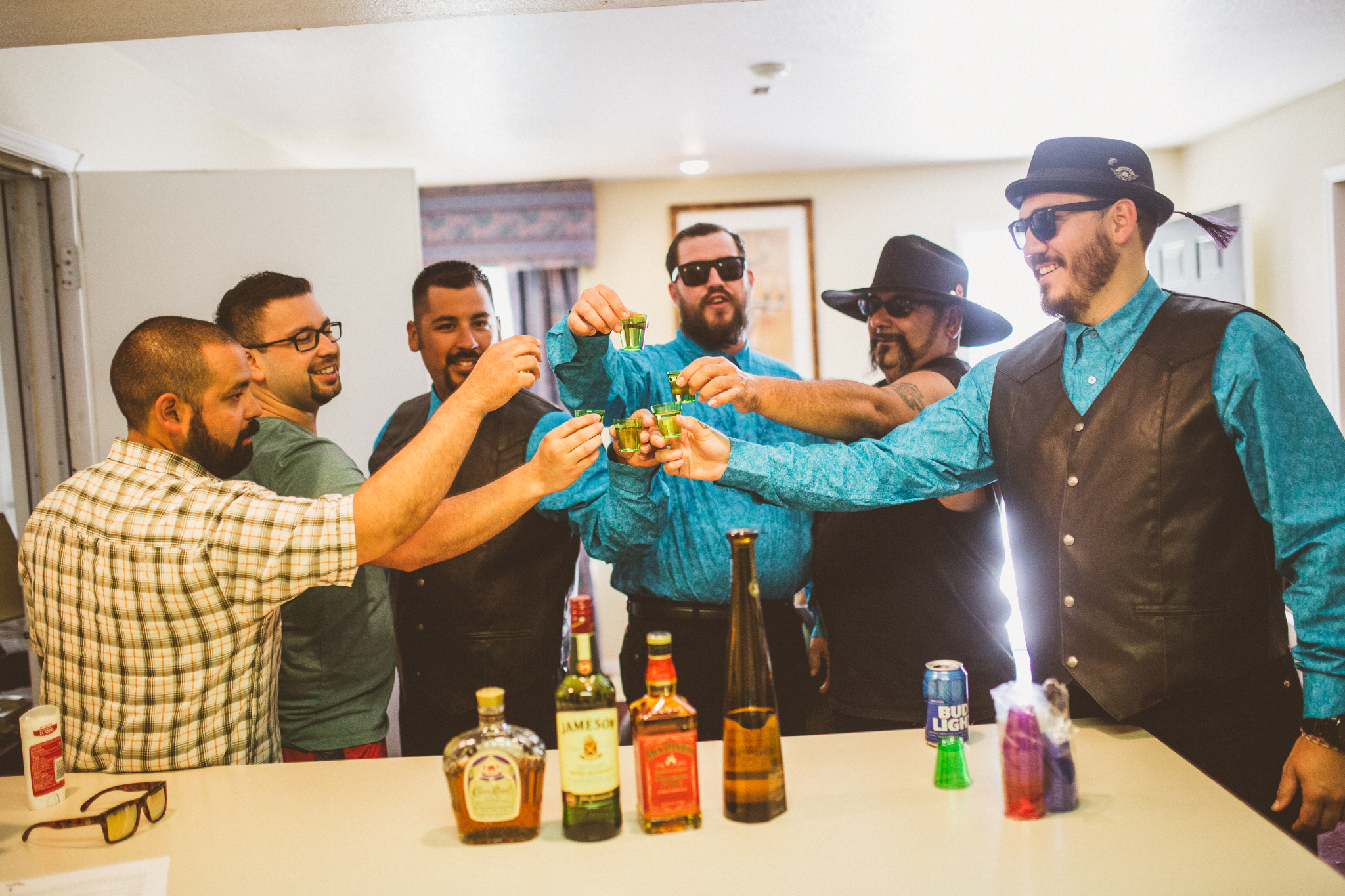 san diego wedding   photographer   men in vests and shades raising a glass