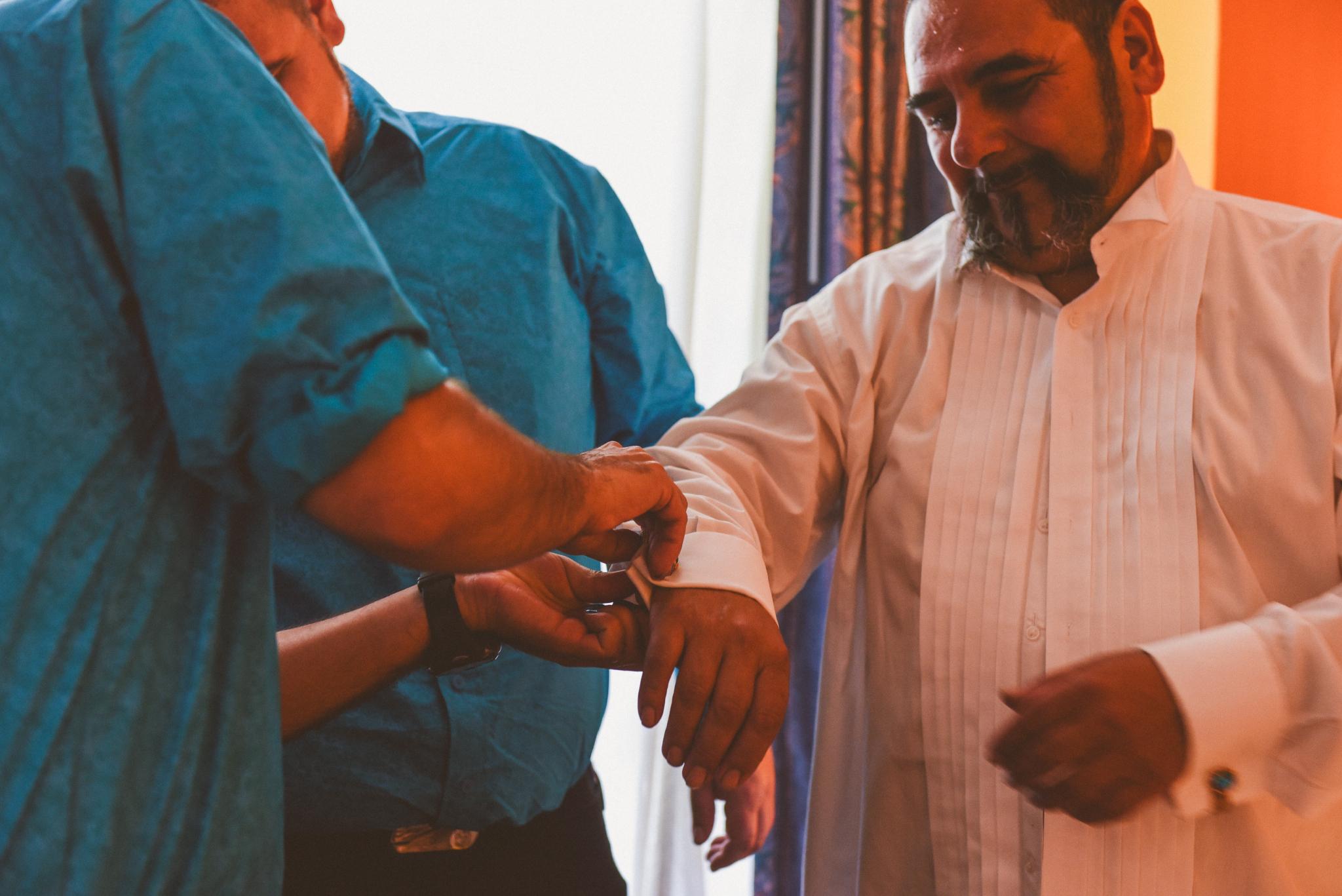 san diego wedding   photographer   men in turquoise shirts helping man fix shirt