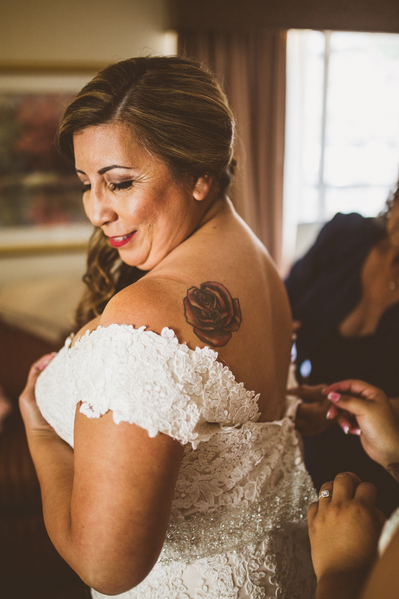 san diego wedding   photographer   woman in wedding dress with rose on shoulder