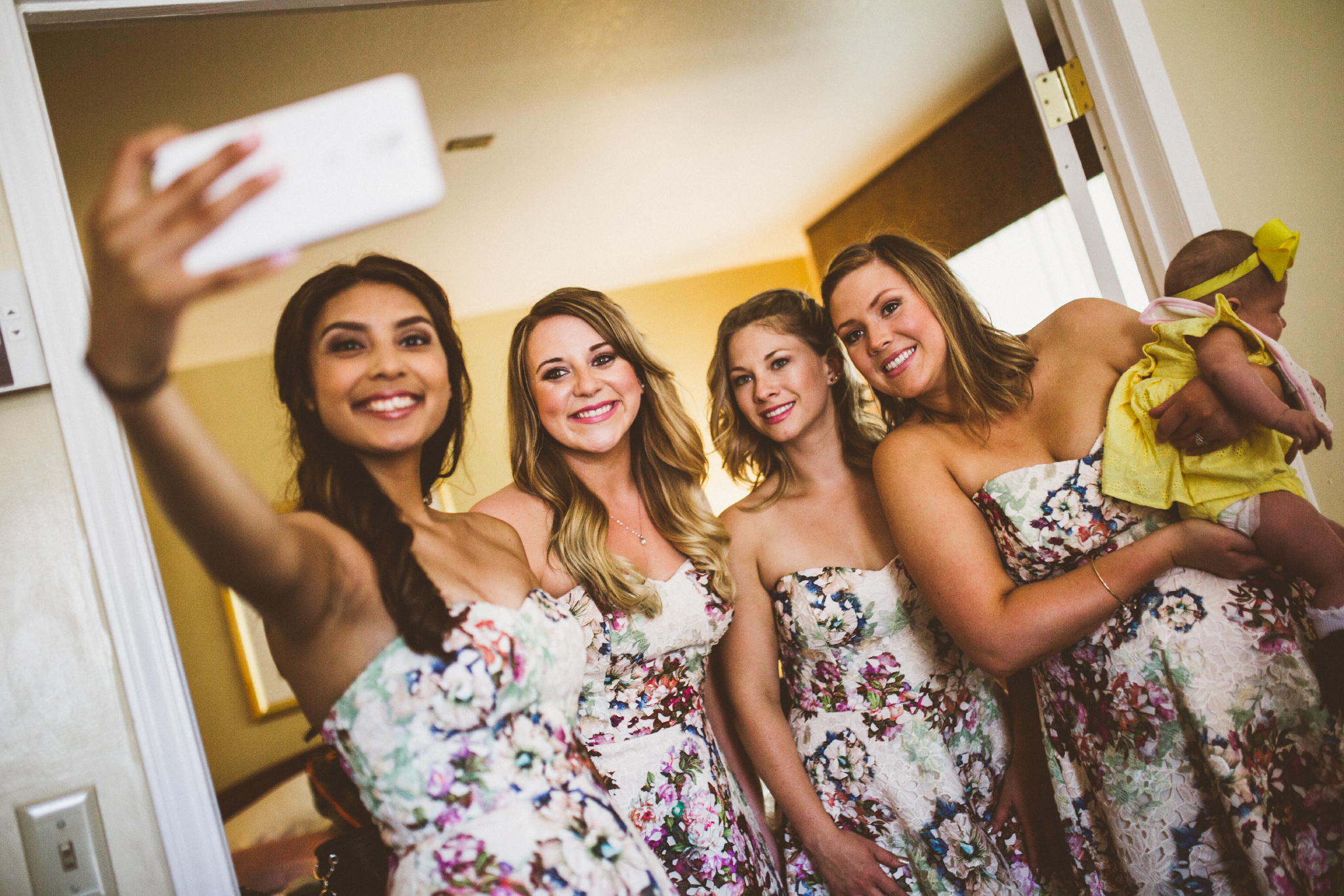 san diego wedding   photographer   bridesmaids in floral dresses with baby in yellow
