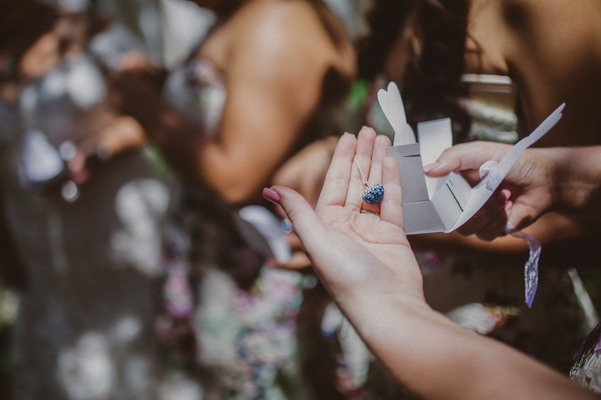 san diego wedding   photographer   bridesmaid checking out content of small box