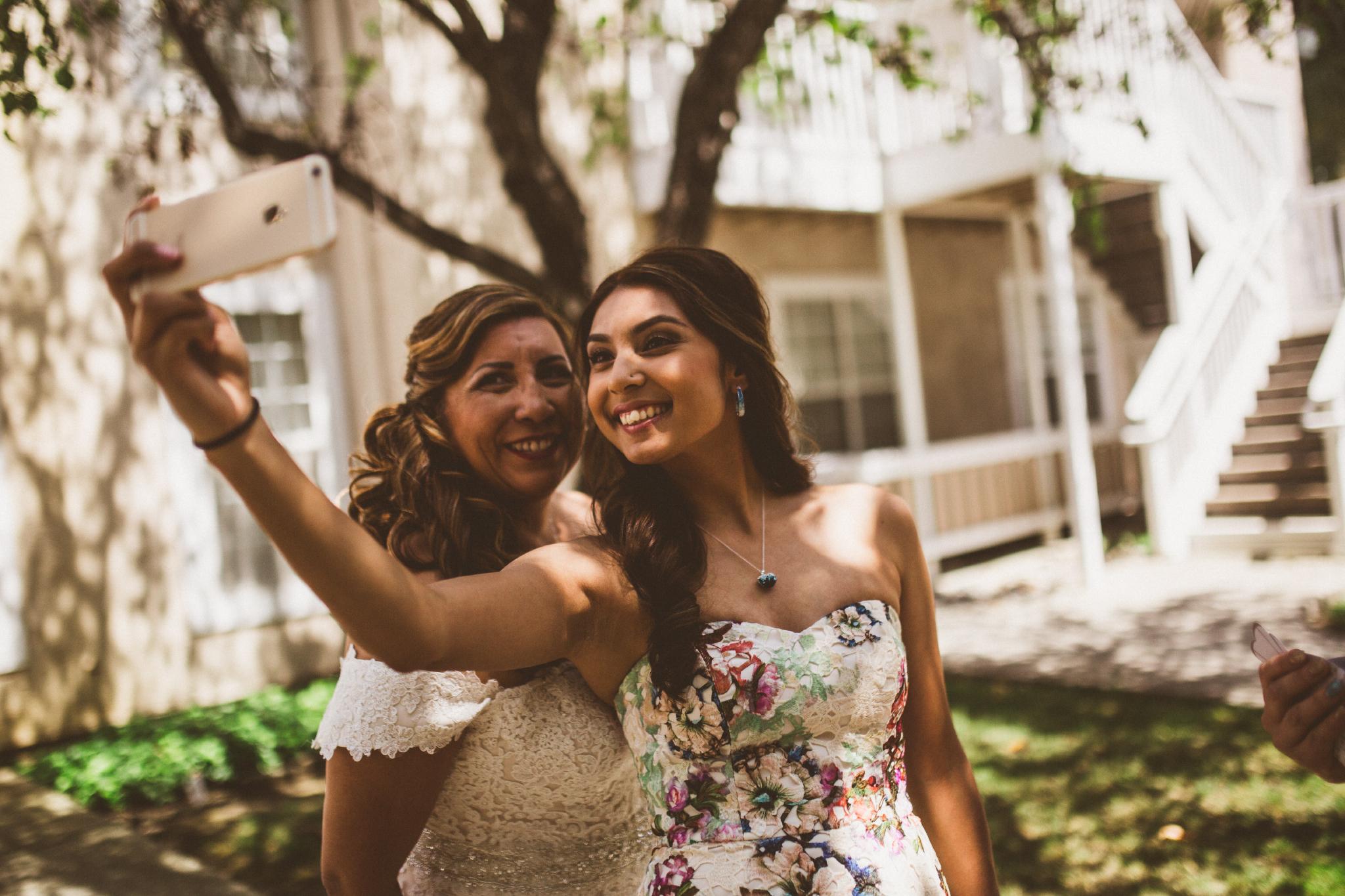 san diego wedding   photographer   bridesmaid taking selfie with bride