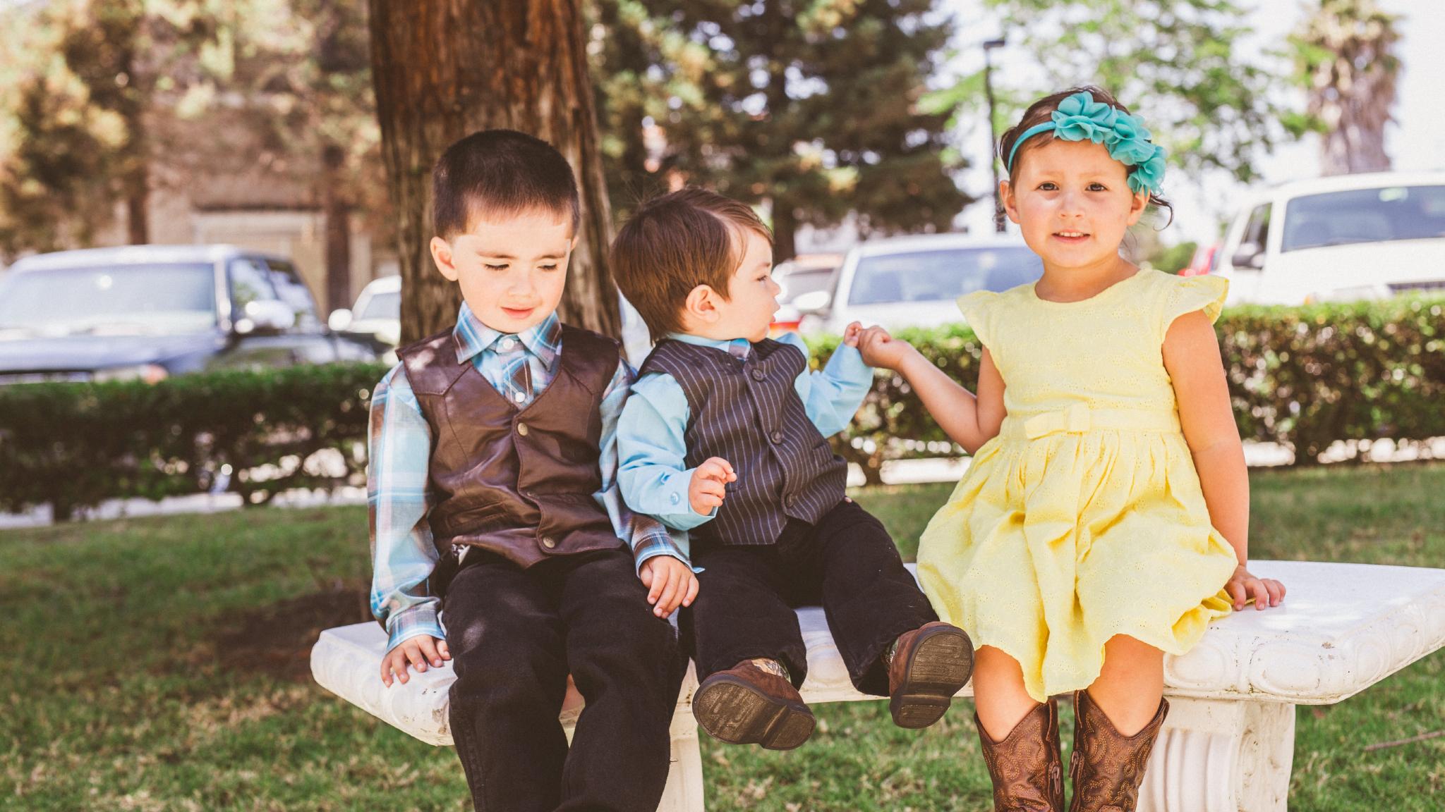 san diego wedding   photographer   children in vests and yellow dress