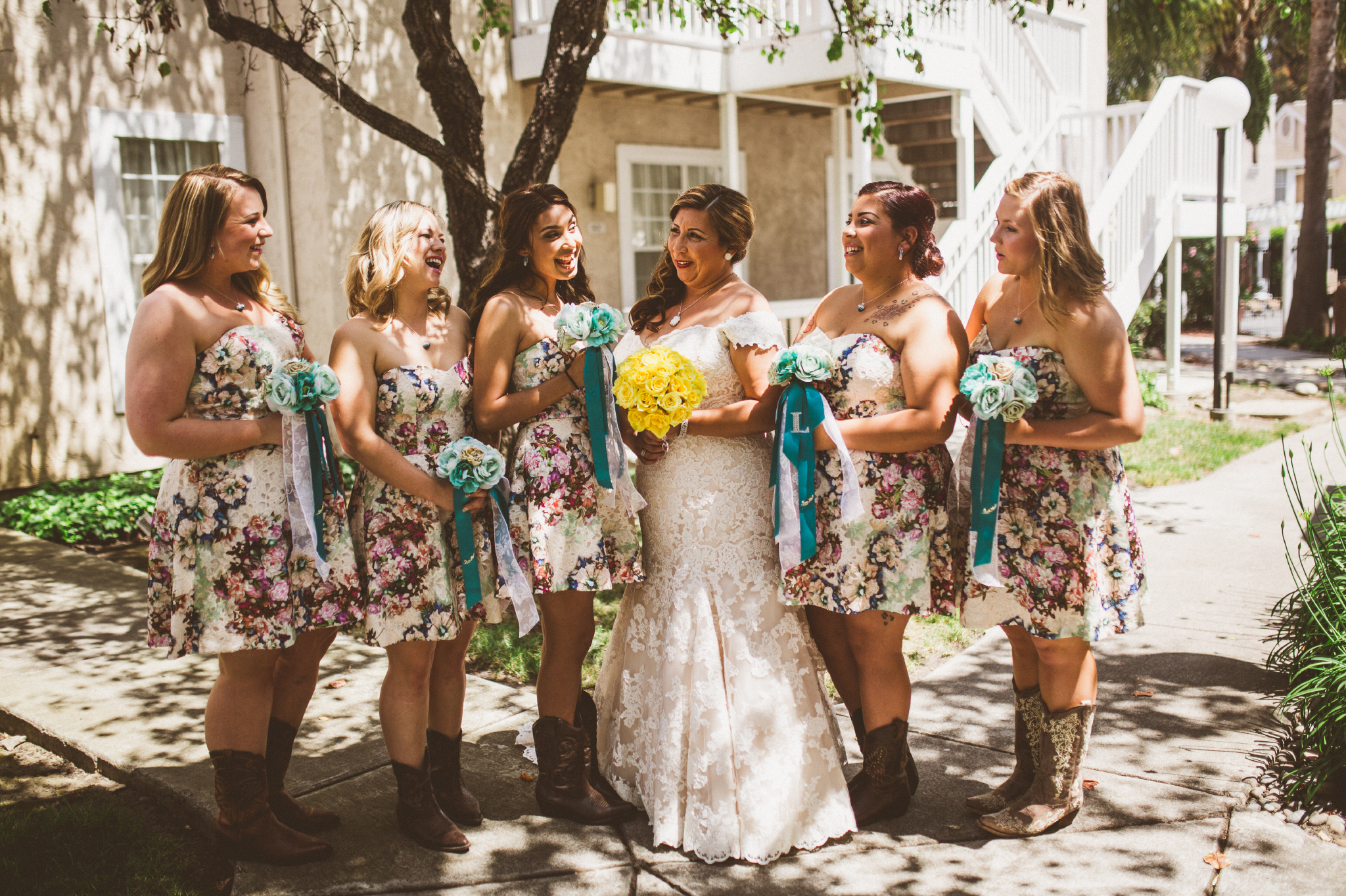 san diego wedding   photographer   bridesmaids posing with bride with yellow bouquet