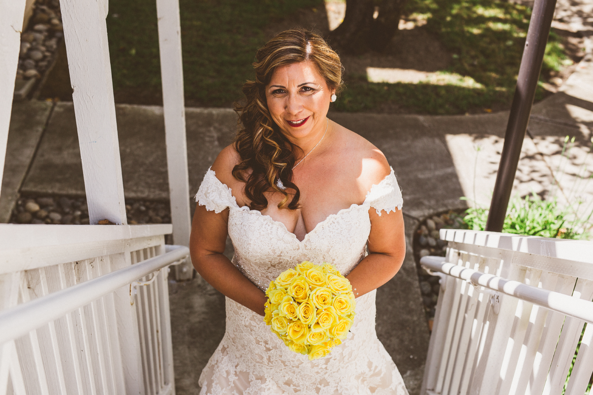 san diego wedding   photographer   bride at bottom of stairs looking up