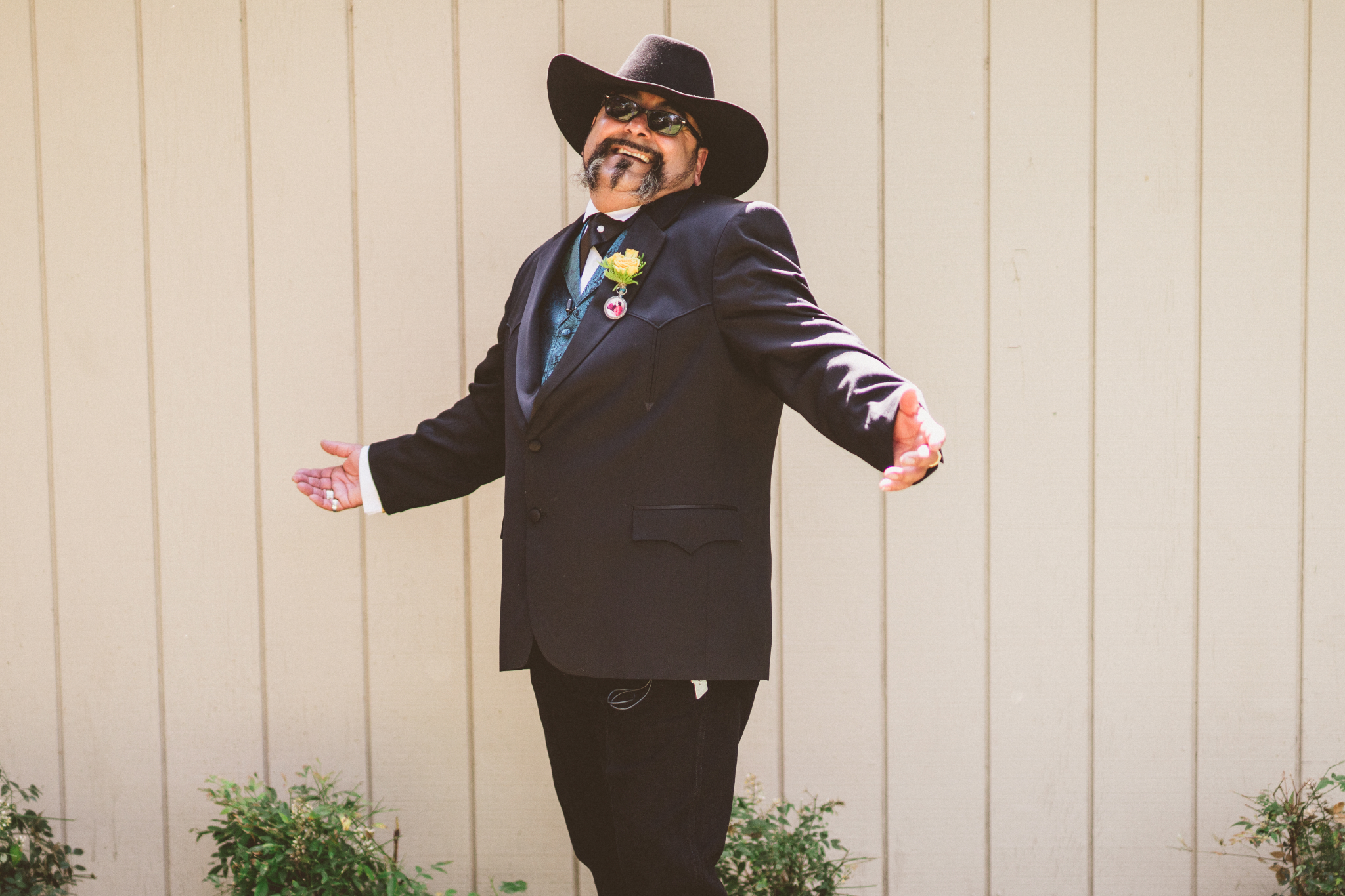 san diego wedding   photographer   groom in suit and cowboy hat posing smiling