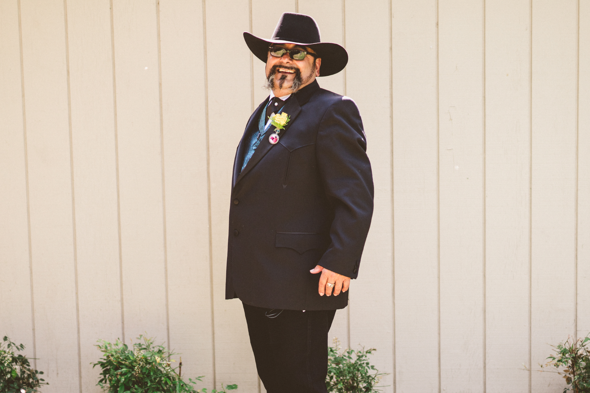 san diego wedding   photographer   groom in suit and cowboy hat standing facing his right
