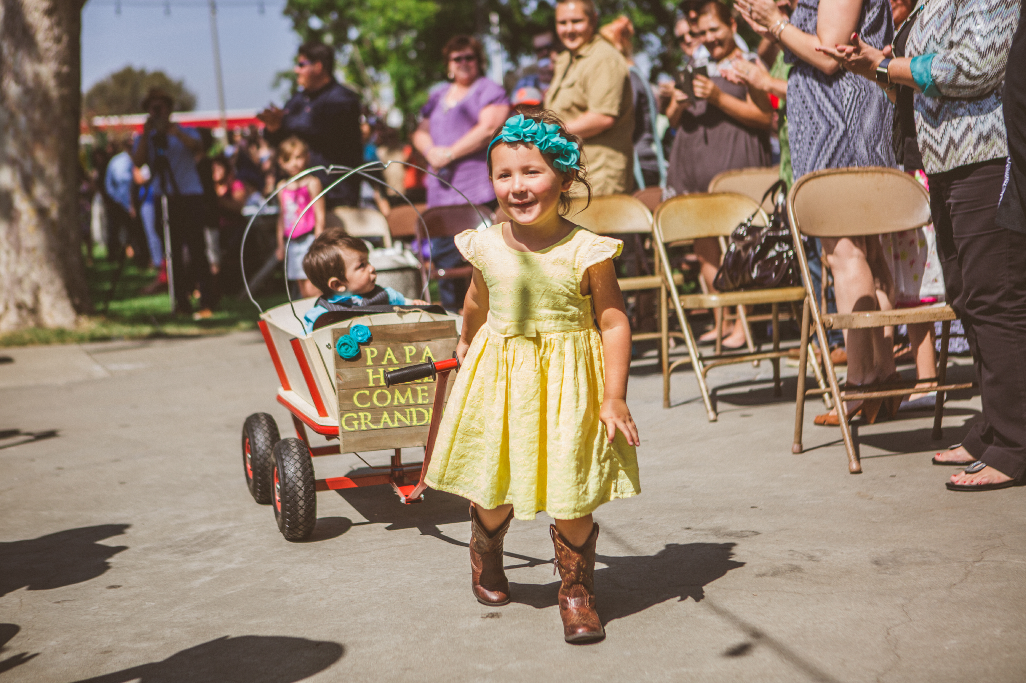 san diego wedding   photographer   child pulling wagon with baby inside