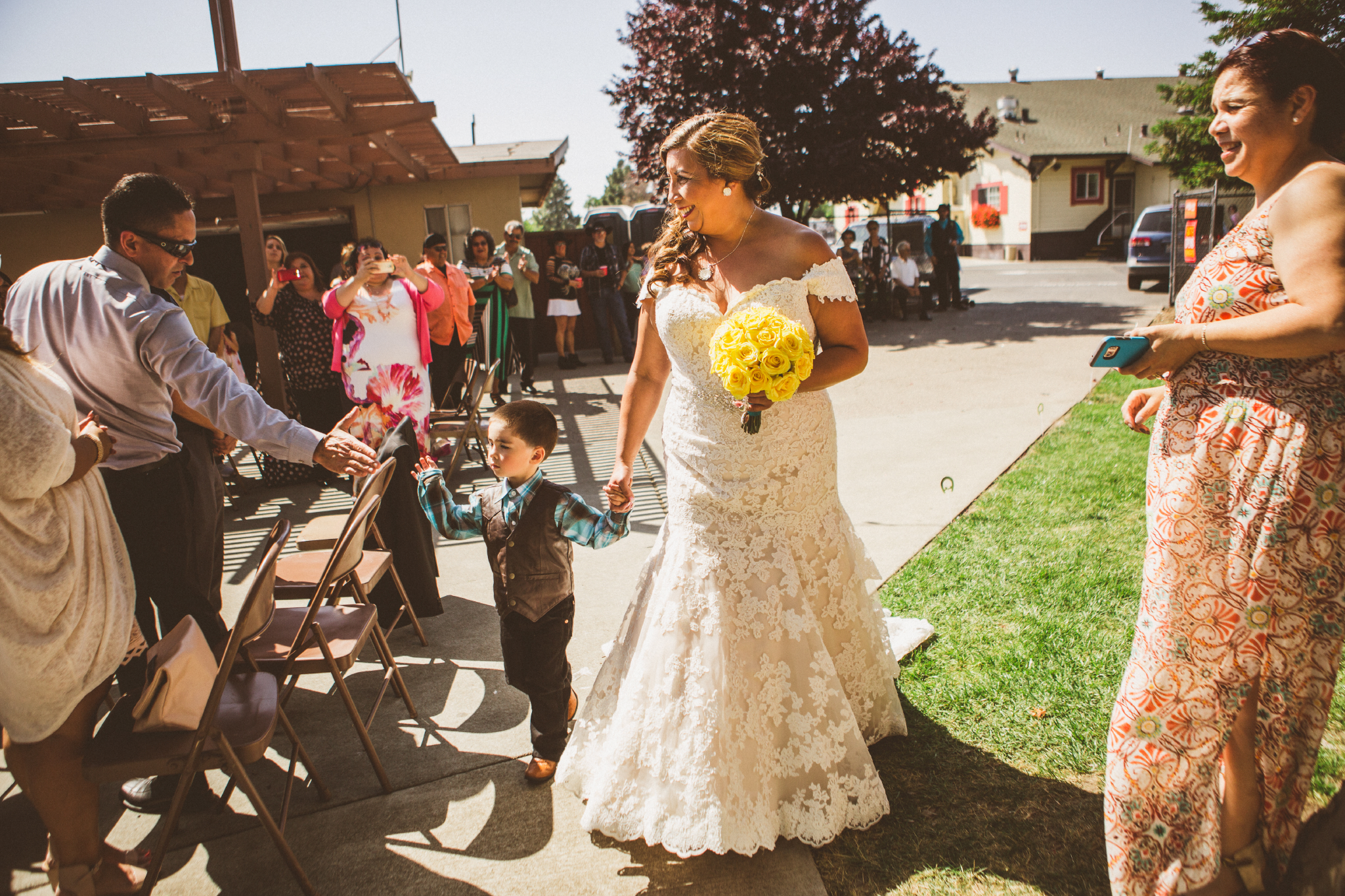 san diego wedding   photographer   bride holding child's hands and bouquet of flowers