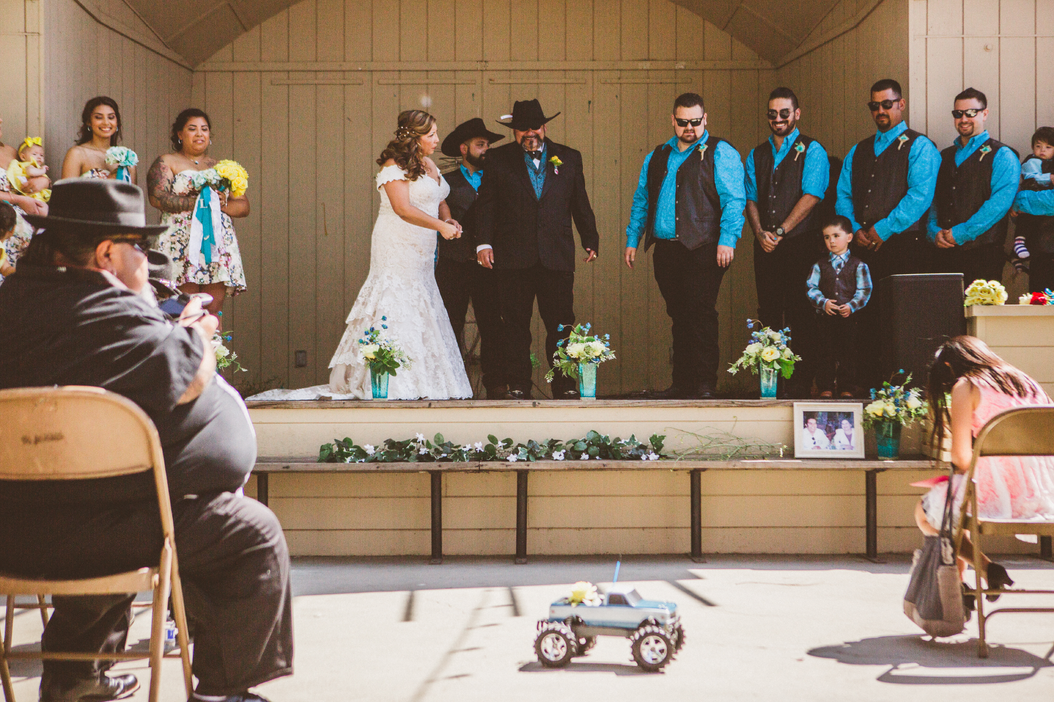 san diego wedding   photographer   bride and groom on platform looking down at toy truck