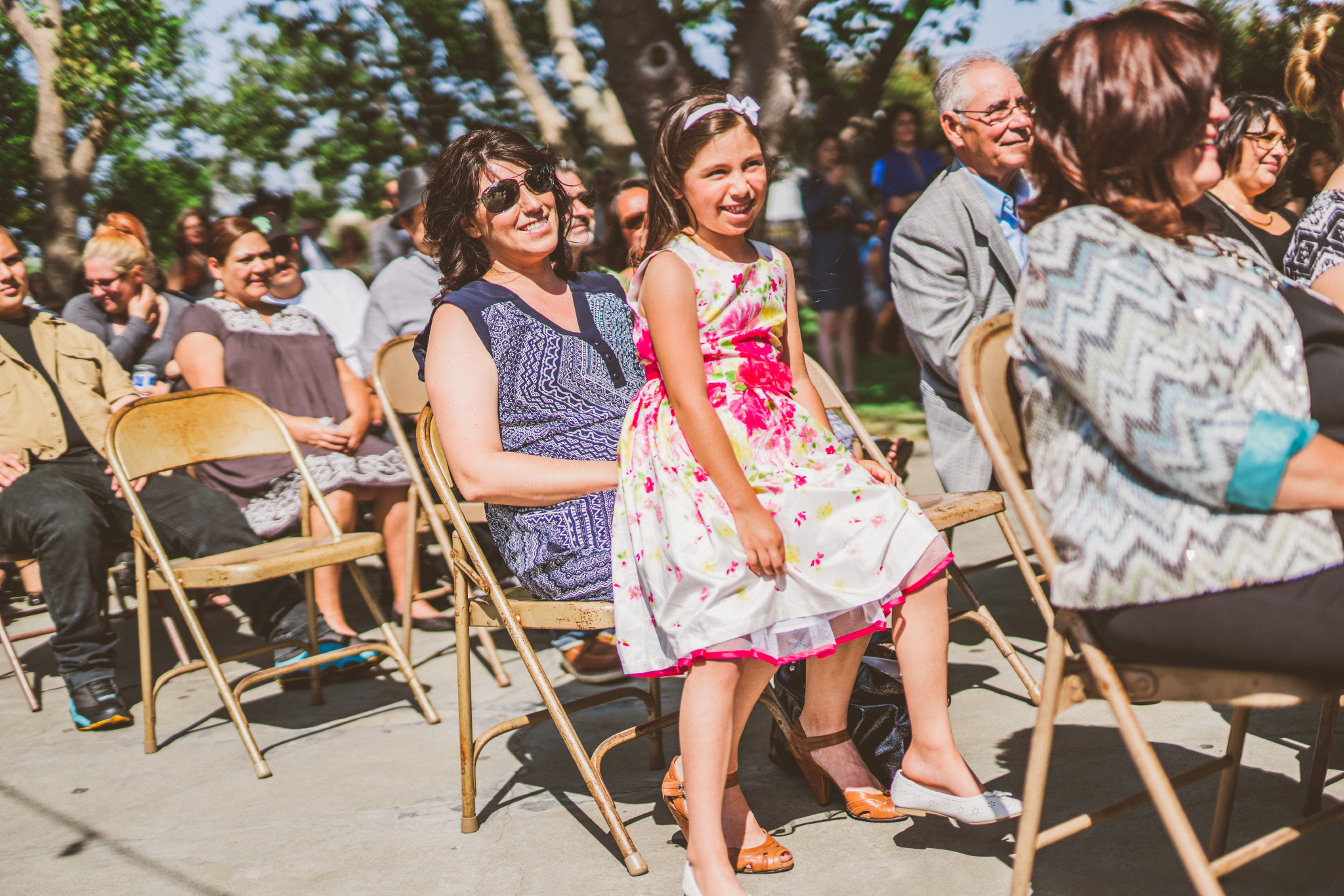 san diego wedding   photographer   crowd sitting on foldable chairs smiling