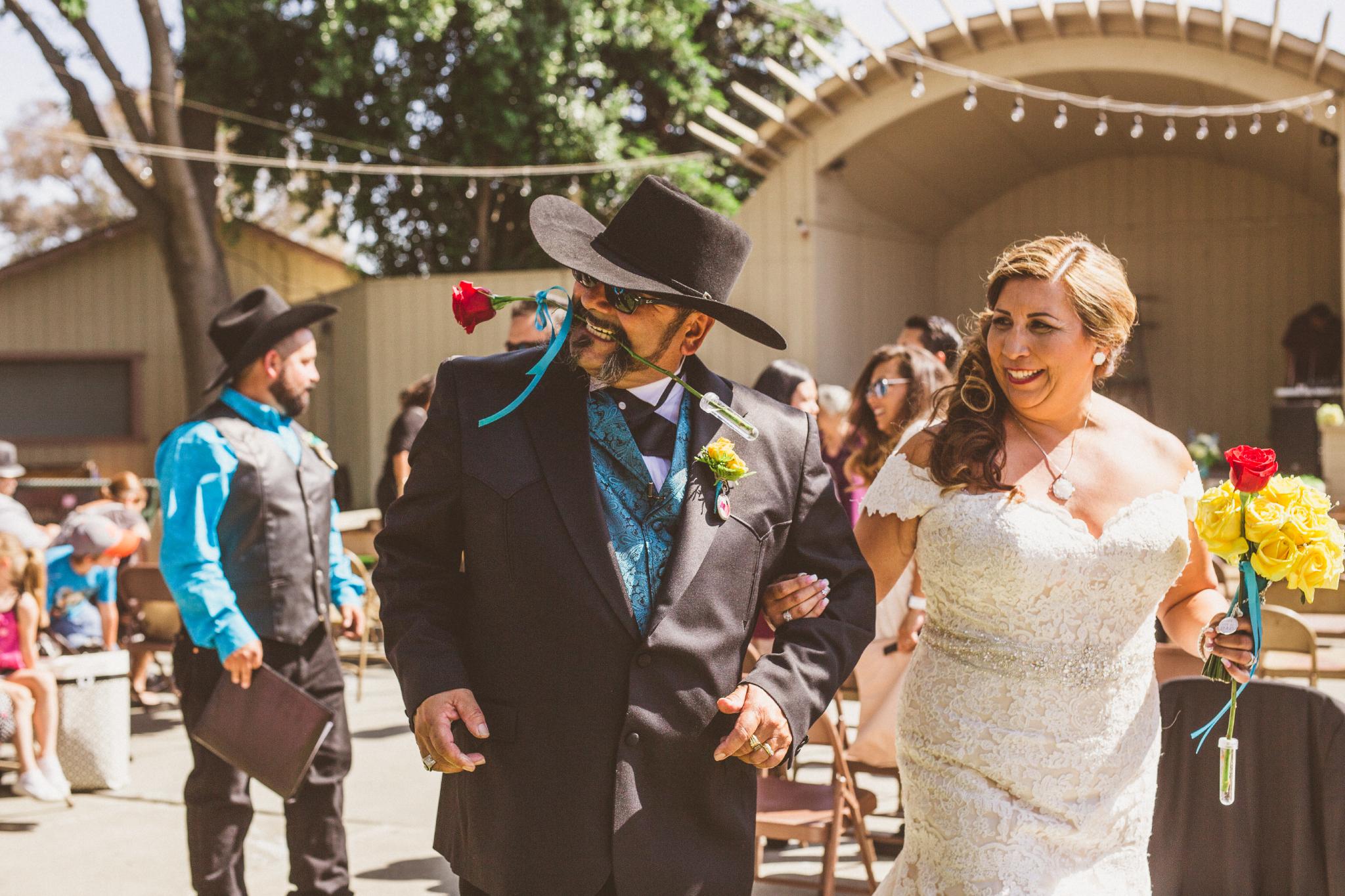 san diego wedding   photographer   groom with rose between teeth with bride