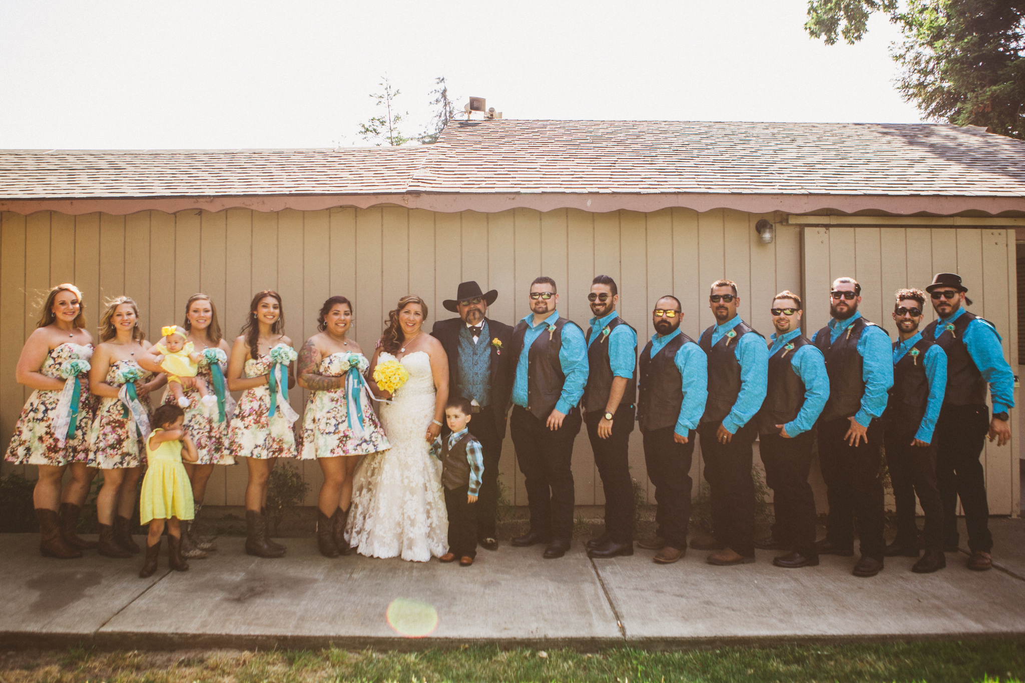 san diego wedding   photographer   lineup of bridesmaids in floral dress and groomsmen in   turquoise