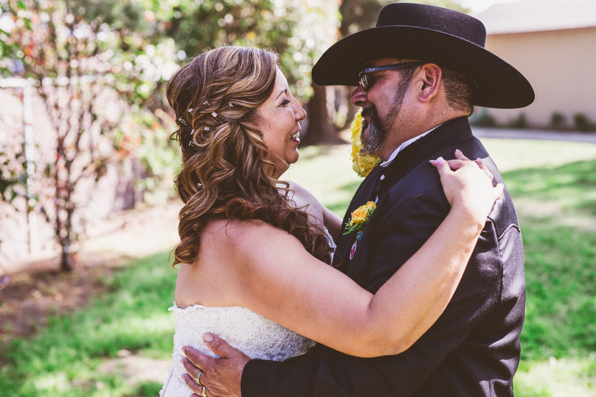 san diego wedding   photographer   bride and groom holding each other and smiling