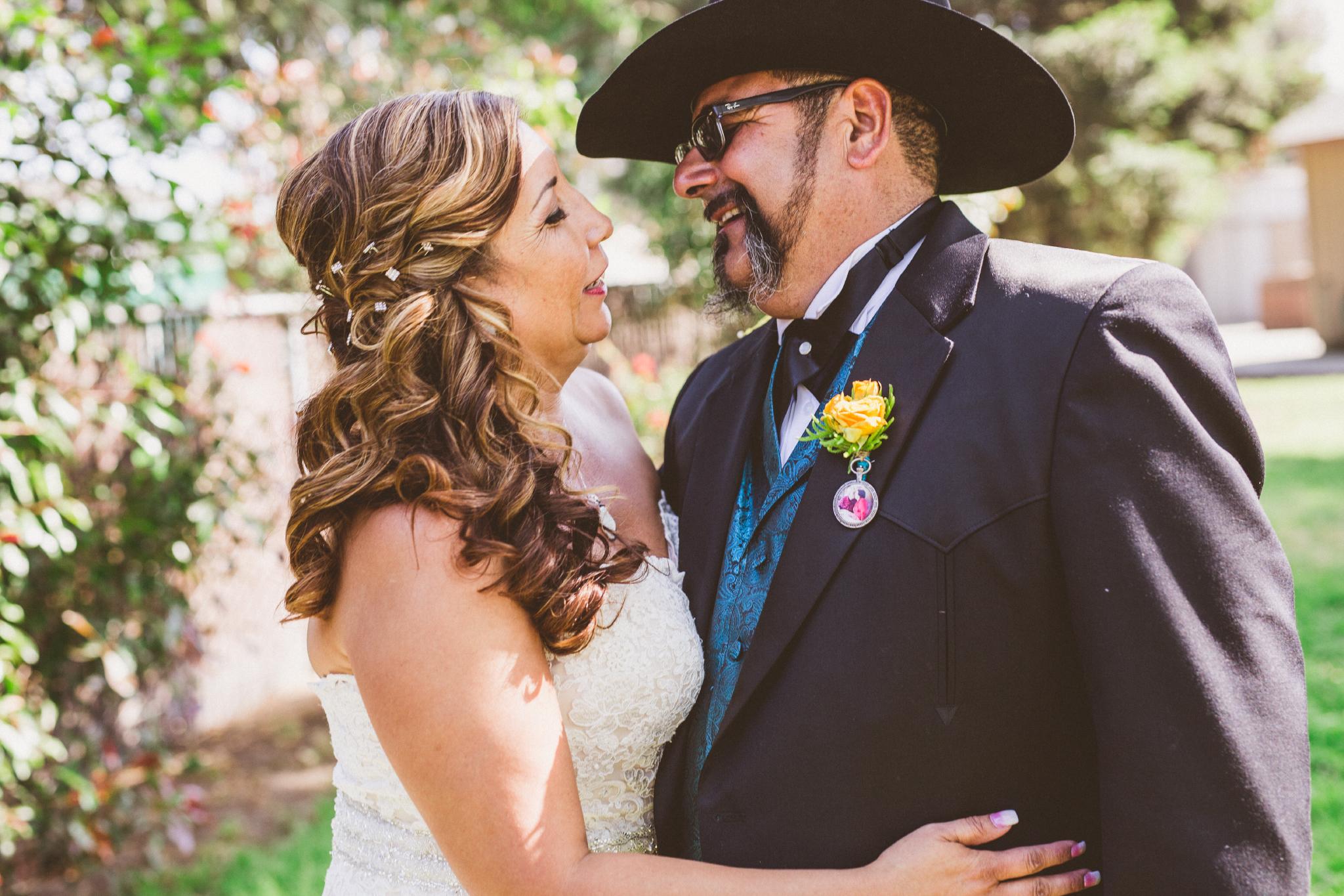 san diego wedding   photographer   bride holding groom in cowboy hat