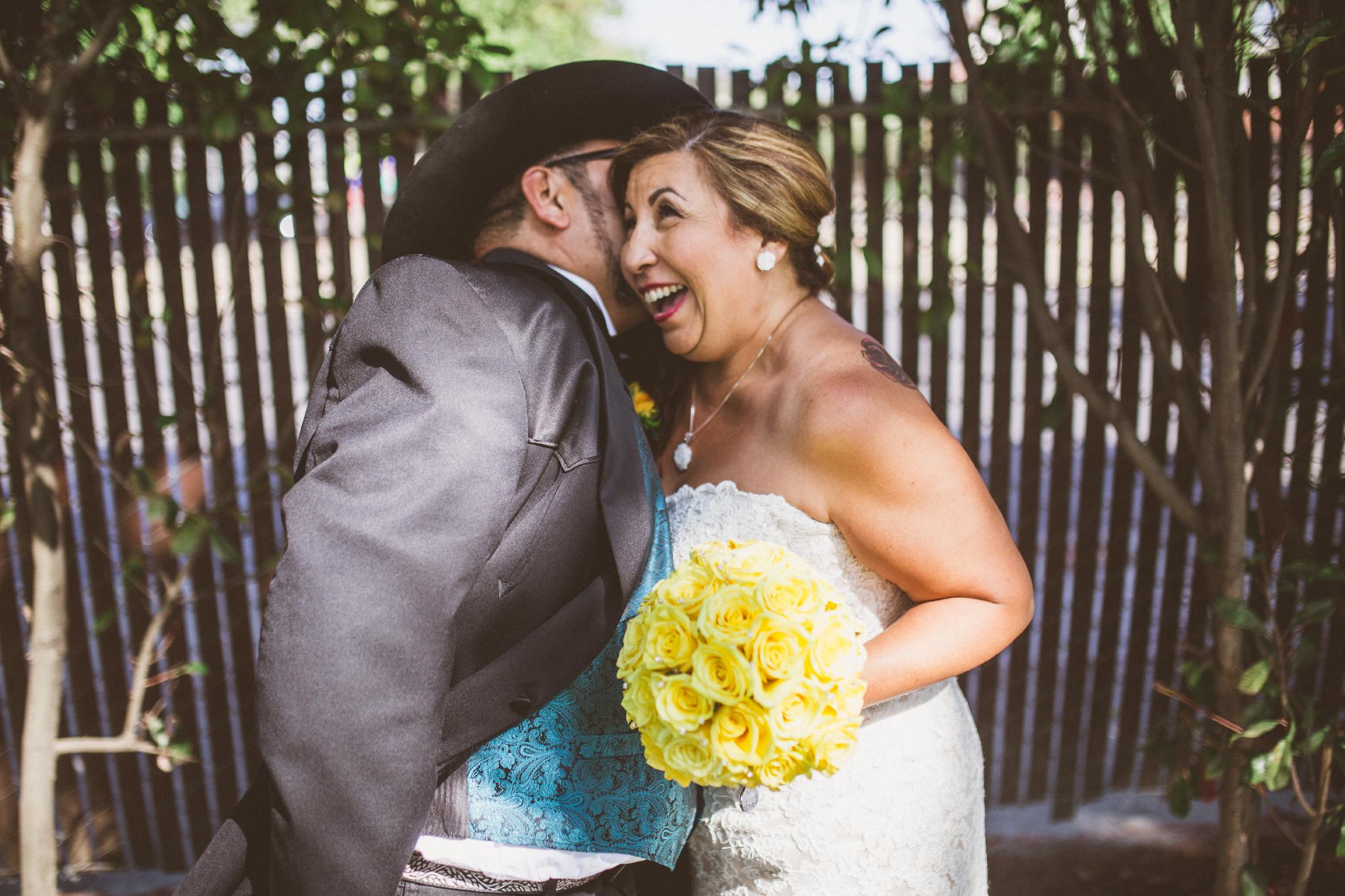 san diego wedding   photographer   groom in cowboy hat kissing surprised bride's ear