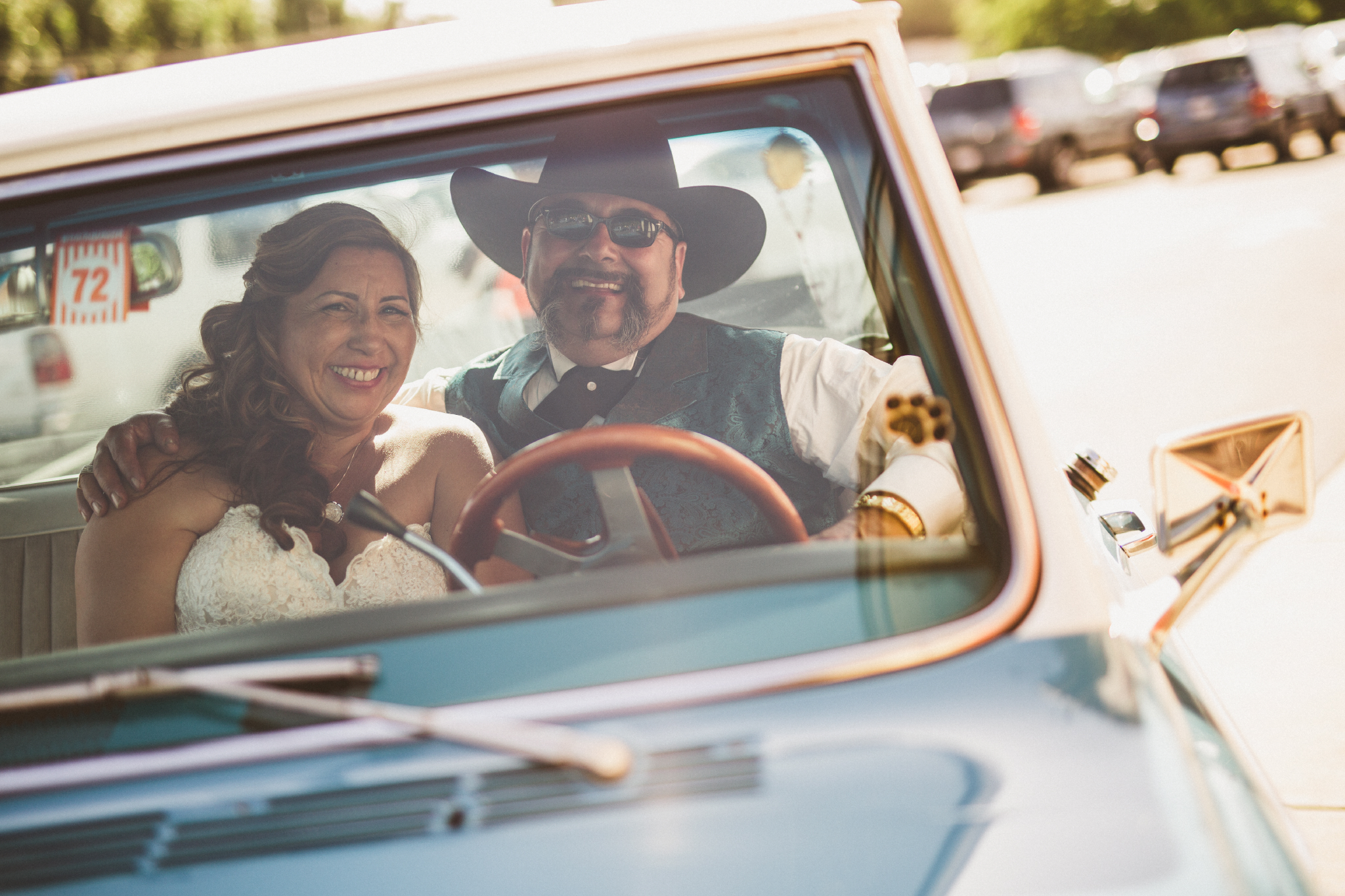 san diego wedding   photographer   groom with cowboy hat and bride both smiling blue pickup truck