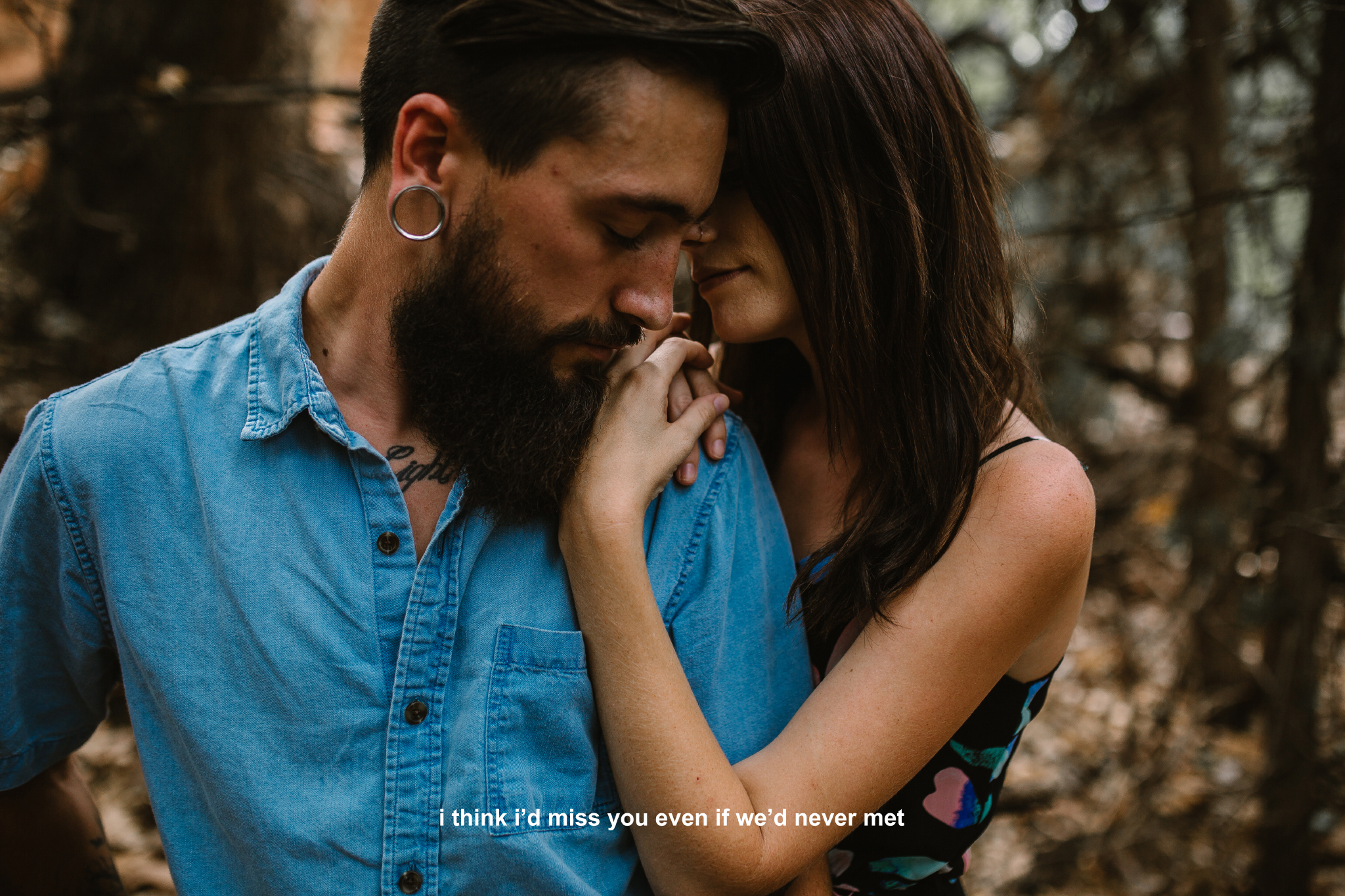 san diego wedding   photographer | bearded man in blue being hugged by woman from behind