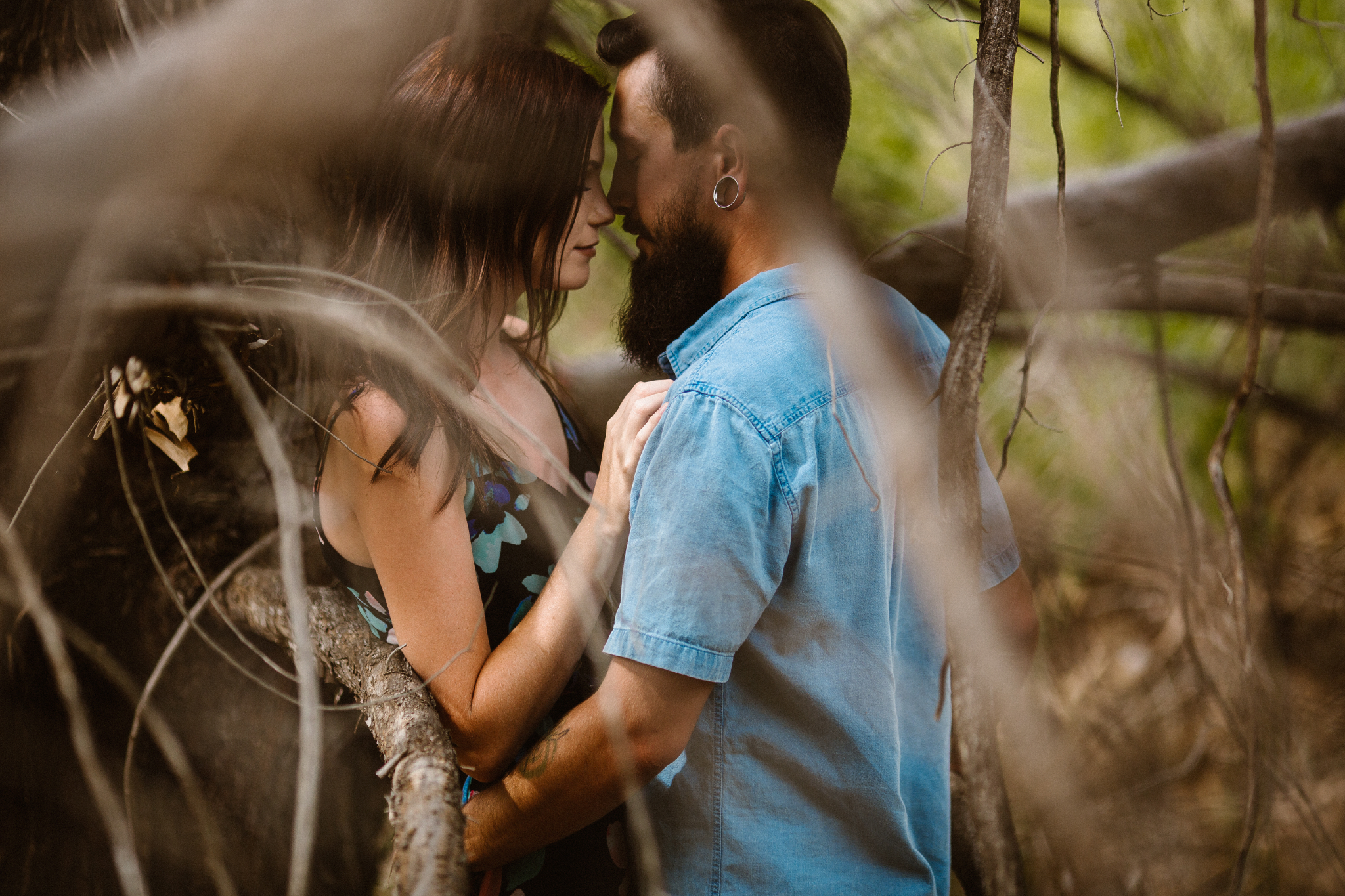 san diego wedding   photographer | bearded man in blue holding woman between dead tree branches