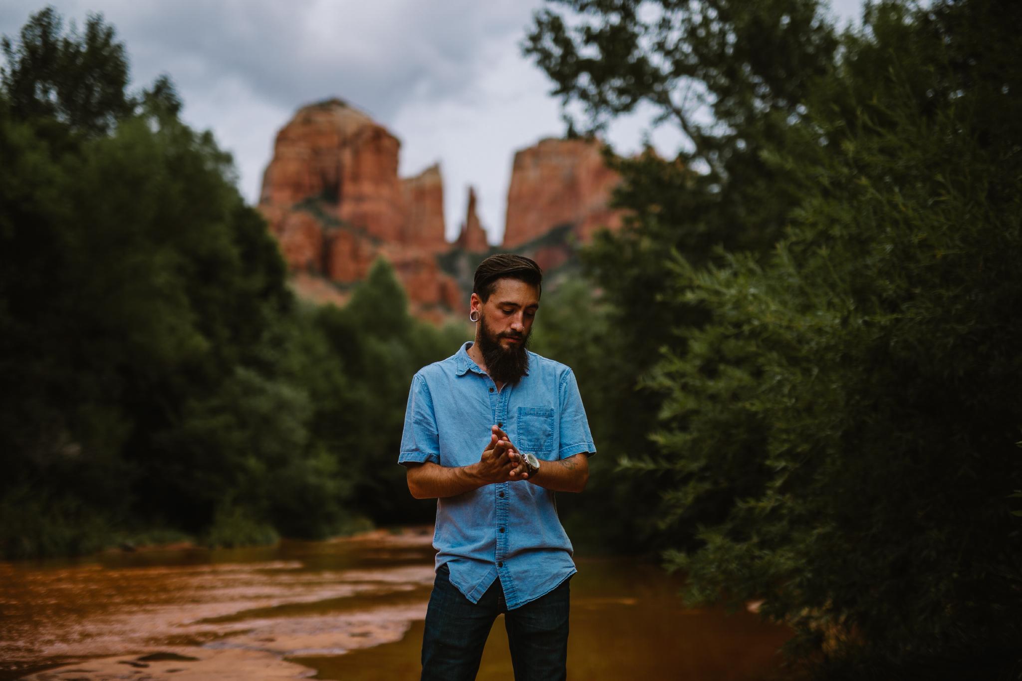 san diego wedding   photographer | bearded man in blue rubbing hands