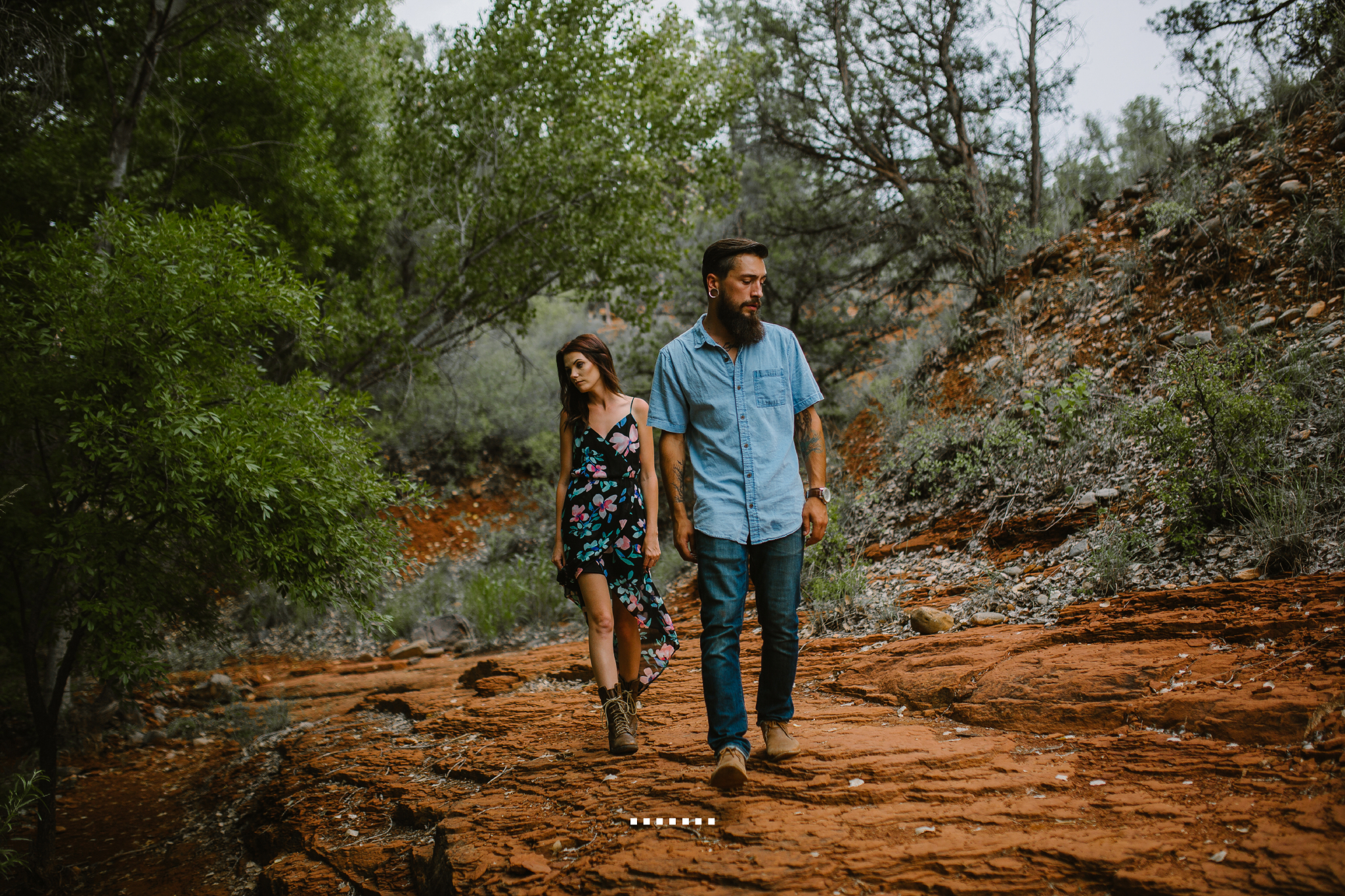 san diego wedding   photographer | bearded man walking with woman in floral black dress behind