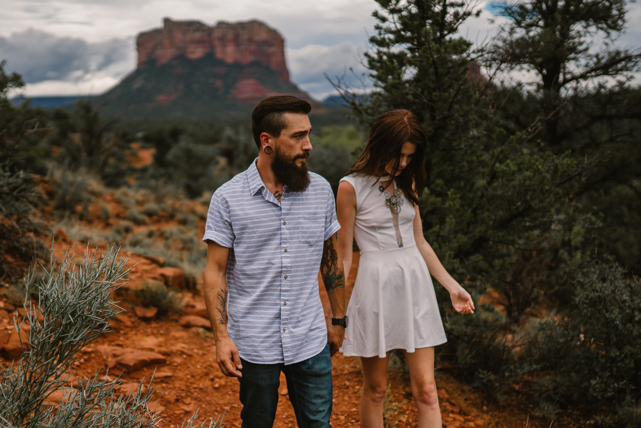 san diego wedding   photographer | bearded man in white with woman in white with canyon on   background
