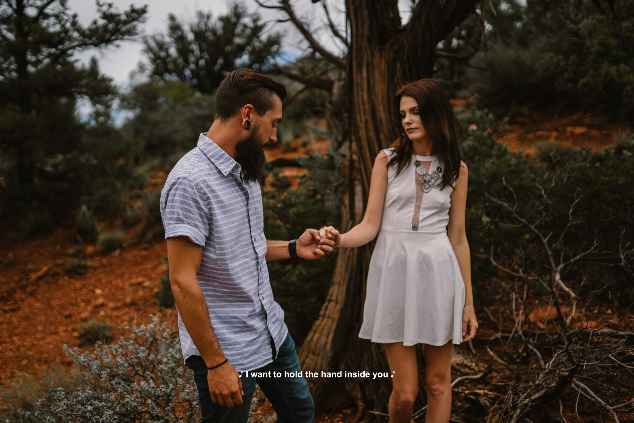 san diego wedding   photographer | bearded man in blue holding woman's hand in white