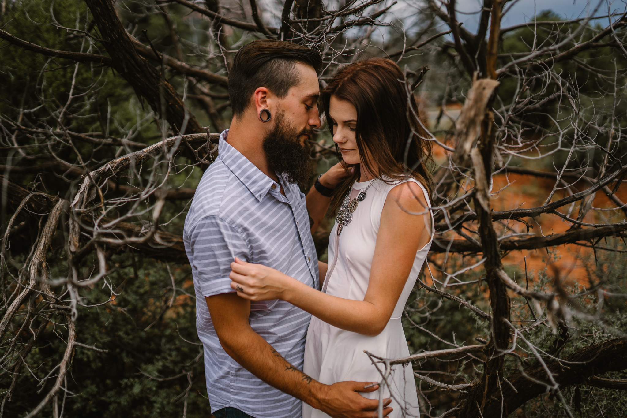 san diego wedding   photographer | bearded man in blue with tunnel earring with woman in white