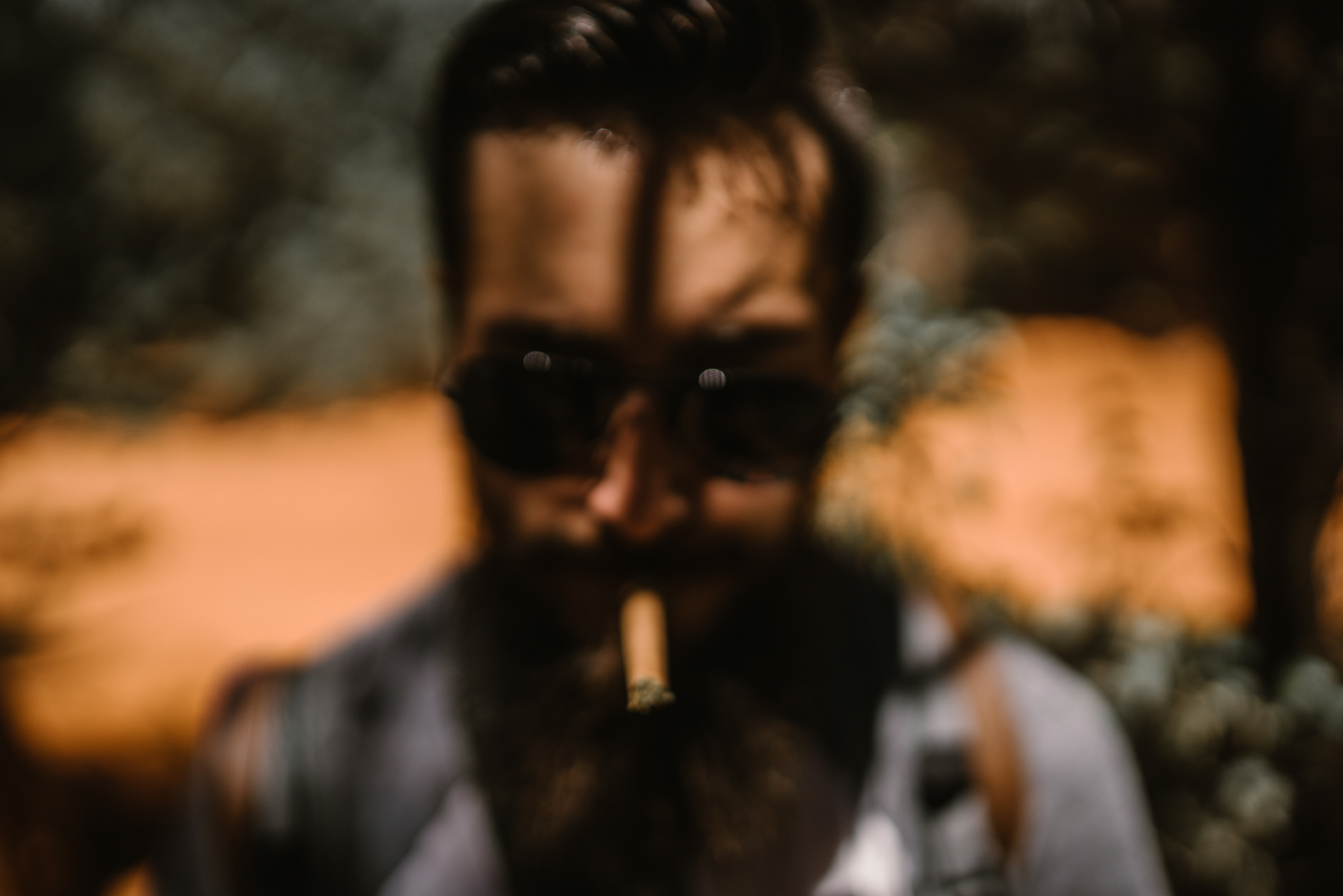 san diego wedding   photographer | out of focus shot of man with cigar