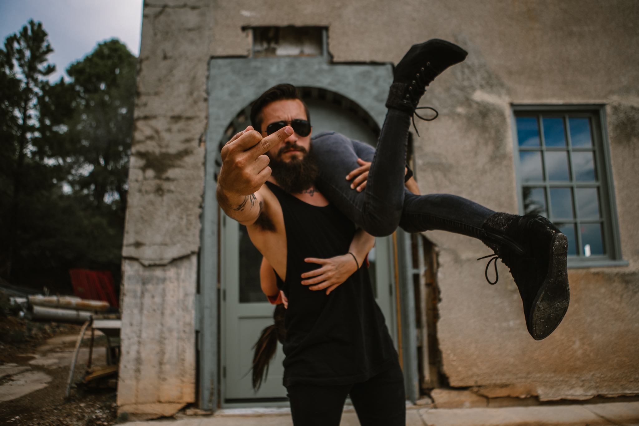 san diego wedding   photographer | bearded man in shades flipping off camera while carrying woman