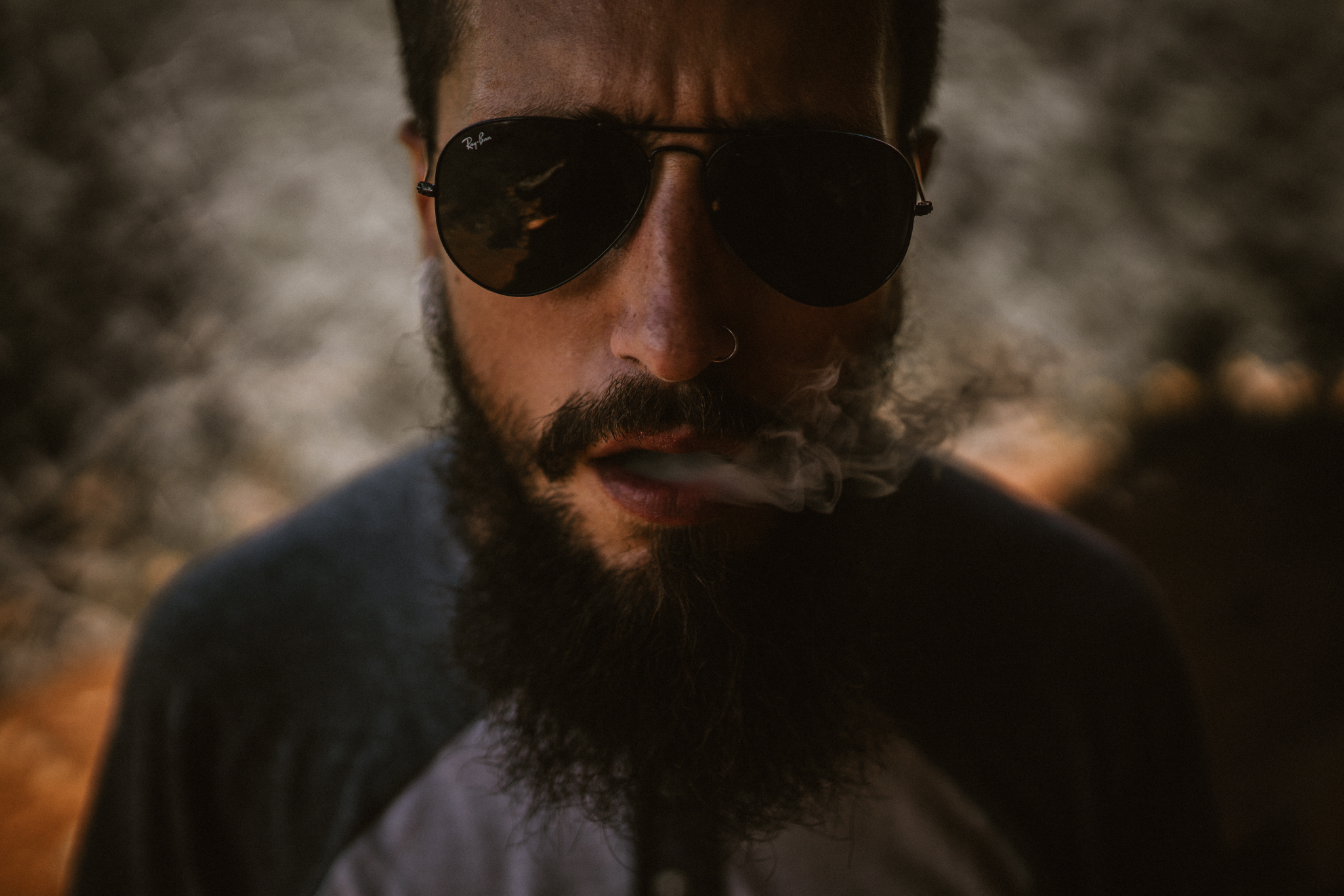 san diego wedding   photographer | bearded man in shades blowing smoke out of his mouth